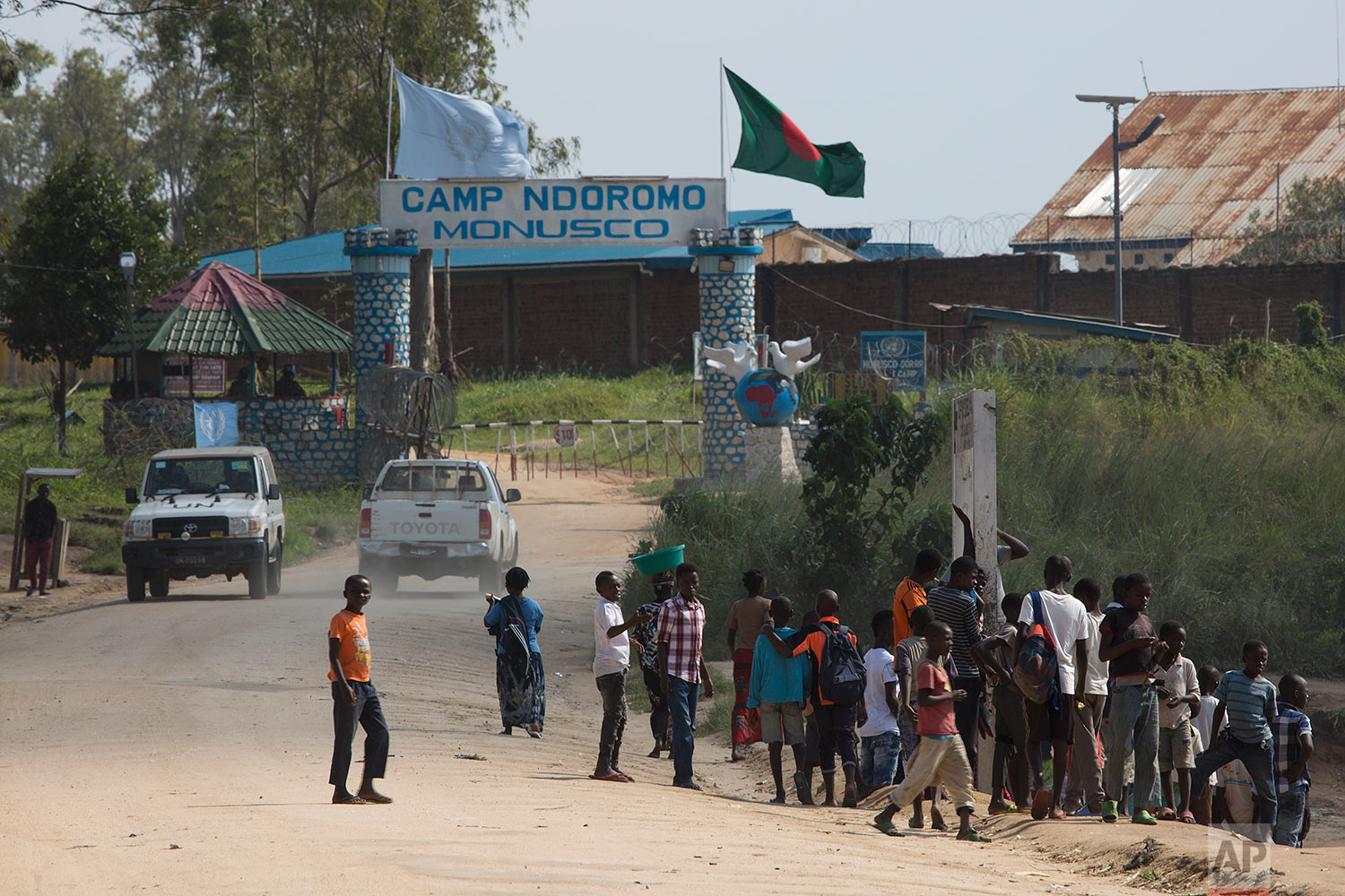 In this photo taken Aug. 10, 2016, people gather outside the UN compound in the Congo Ituri province capital Bunia. (AP Photo/Jerome Delay)