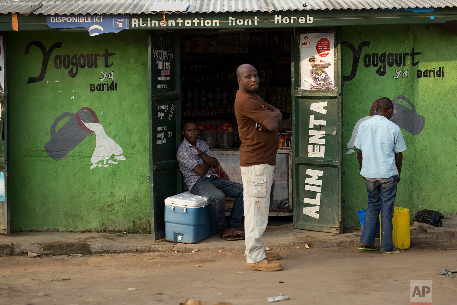 In this photo taken Aug. 10, 2016, a man stands at the entrance of a shop in the Congo Ituri province capital Bunia. (AP Photo/Jerome Delay)