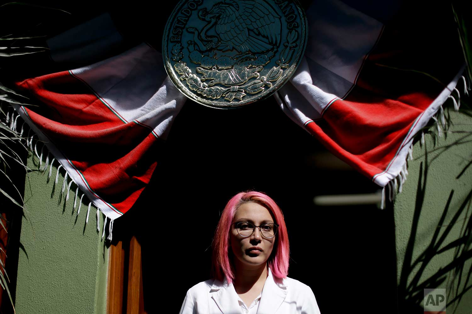 Dr. Karen Pina Fragoso poses for a portrait at the home being used as a safe-house for personal items being pulled from the rubble across the street from an apartment building that collapsed from an earthquake in the Condesa neighborhood of Mexico City,Sept. 22, 2017. (AP Photo/Natacha Pisarenko)