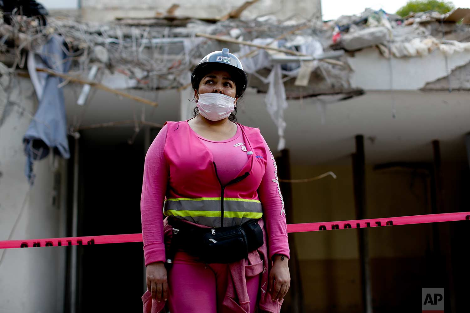 Volunteer rescue worker Lizabeth Yazmin Lopez poses for a portrait outside a collapsed building, Sept. 22, 2017, in Mexico City.(AP Photo/Natacha Pisarenko)