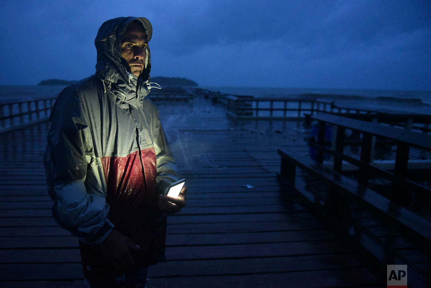 David Cruz Marrero watches the waves at Punta Santiago pier hours before the imminent impact of Maria, a Category 5 hurricane that threatens to hit the eastern region of the island with sustained winds of 165 miles per hour, in Humacao, Puerto Rico, Tuesday, September 19, 2017. (AP Photo/Carlos Giusti)