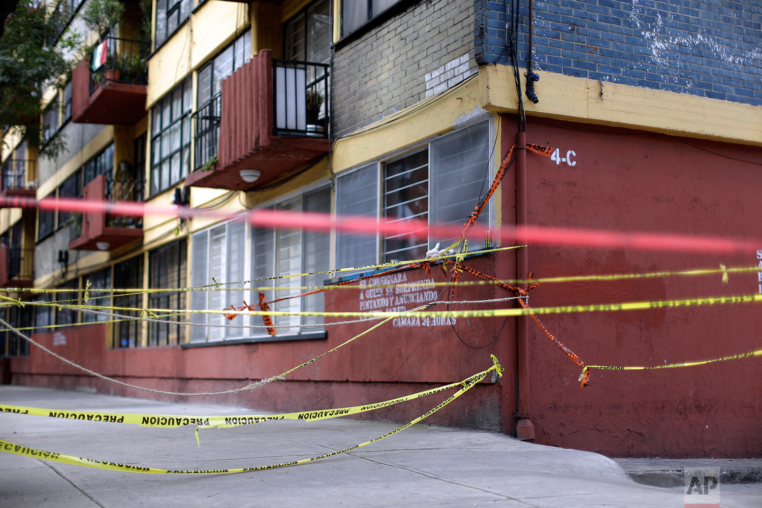 Caution tape blocks a large apartment complex in the southern neighborhood of Tlalpan in Mexico City, Monday, Sept. 25, 2017. (AP Photo/Natacha Pisarenko)