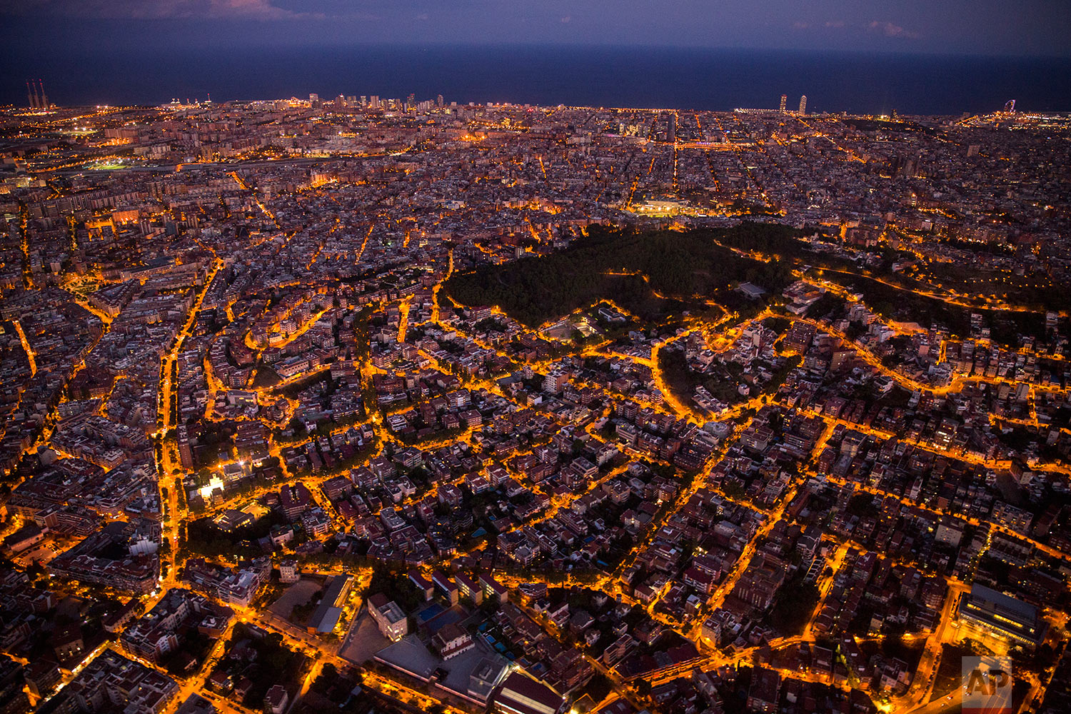 In this Tuesday, Sept. 19, 2017 photo, an aerial view of the city of Barcelona, Spain taken from a patrol in a helicopter of the Catalan Mossos d'Esquadra. (AP Photo/Emilio Morenatti)