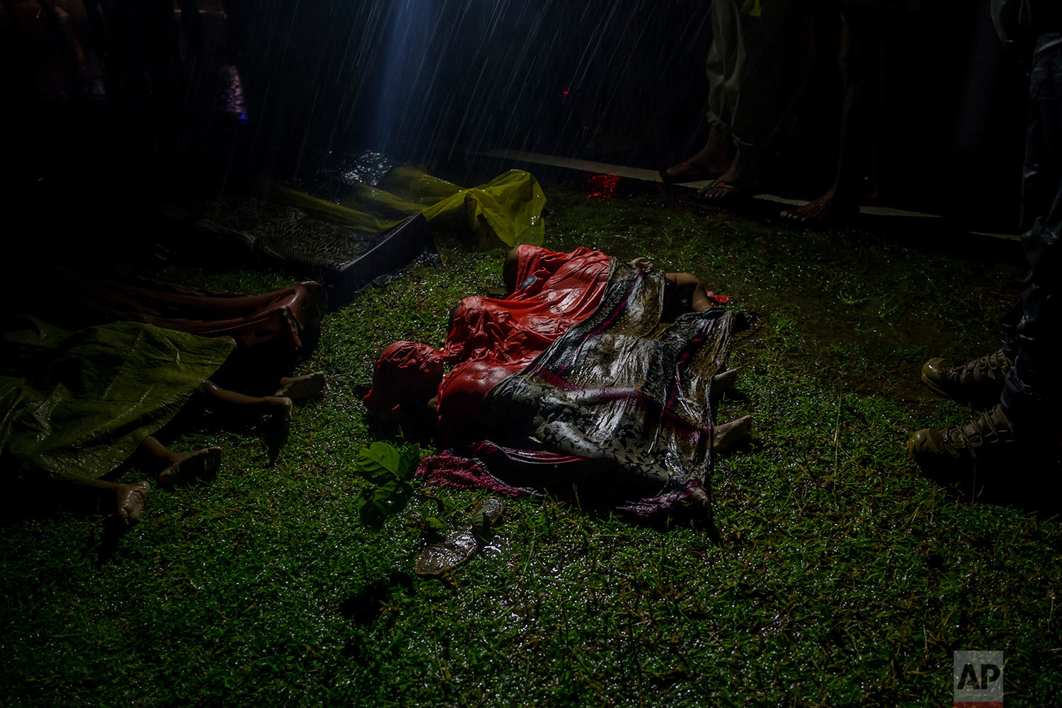 Bodies of Rohingya Muslim children, who died after their boat capsized in the Bay of Bengal as they were crossing over from Myanmar into Bangladesh, lies on a roadside near Inani beach, in Cox's Bazar district, Bangladesh, Thursday, Sept. 28, 2017. (AP Photo/Dar Yasin)