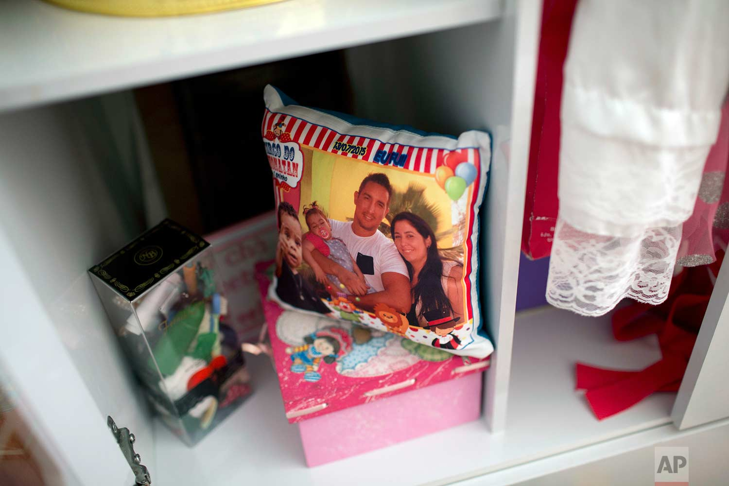 This Aug. 17, 2017 photo shows a souvenir pillow from a birthday party attended by the family of police officer Felipe Fernandes, in Rio de Janeiro, Brazil. (AP Photo/Silvia Izquierdo)