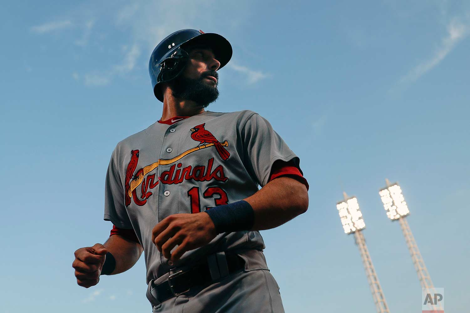 St. Louis Cardinals' Matt Carpenter runs towards the dugout after hitting a solo home run off Cincinnati Reds starting pitcher Rookie Davis in the first inning of a baseball game, Wednesday, Sept. 20, 2017, in Cincinnati. (AP Photo/John Minchillo)