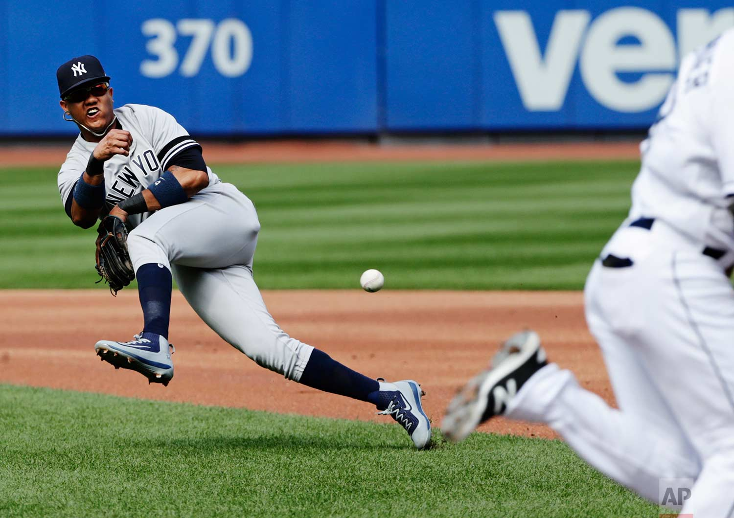 New York Yankees second baseman Starlin Castro attempts to throw out Tampa Bay Rays' Kevin Kiermaier at first base during the first inning of a baseball game Wednesday, Sept. 13, 2017, in New York. Kiermaier was safe at first base on the play. (AP Photo/Frank Franklin II)