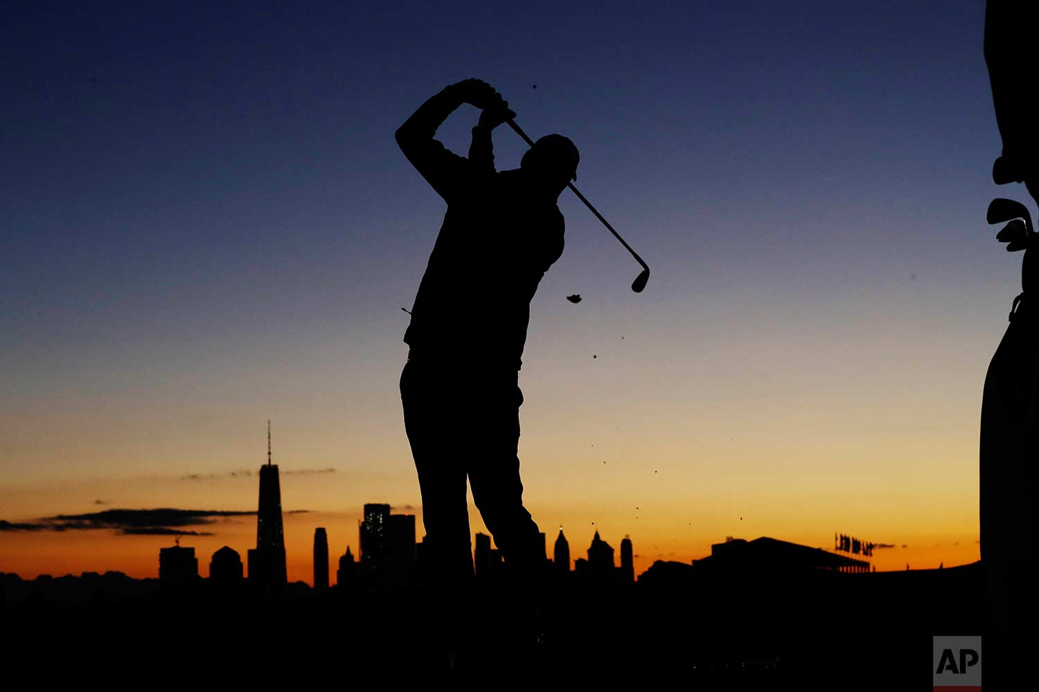 Marc Leishman practices on the driving range before the start of play during the third day of the Presidents Cup at Liberty National Golf Club in Jersey City, N.J., Saturday, Sept. 30, 2017. (AP Photo/Julio Cortez)