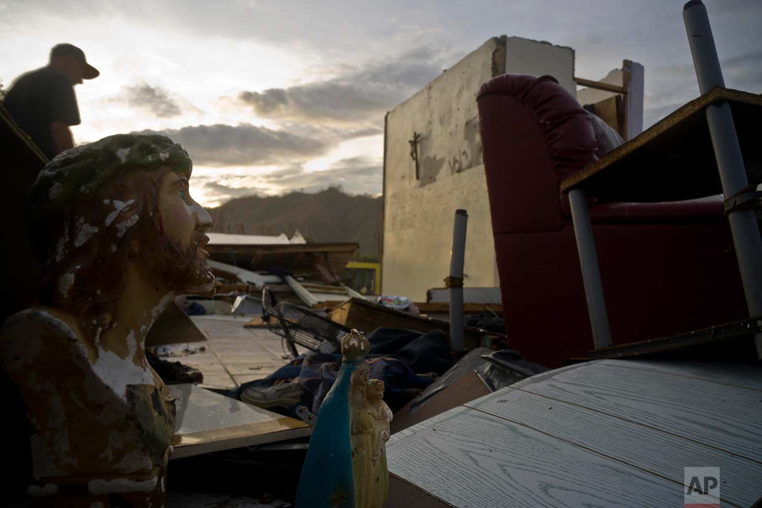 Luis Cosme walks in the remains of his house destroyed by Hurricane Maria, in Morovis, Puerto Rico, Sunday, Oct. 1, 2017.  (AP Photo/Ramon Espinosa)