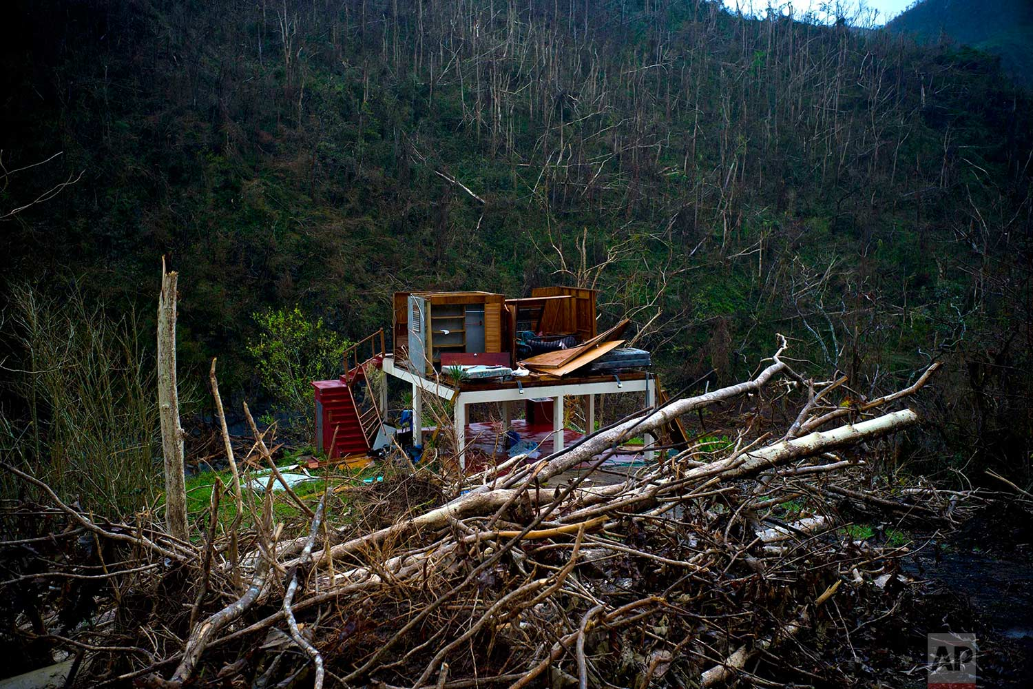 In this Saturday, Sept. 30, 2017 photo, the foundation of a heavily damaged house stands in the mountains after the passing of Hurricane Maria in the San Lorenzo neighborhood of Morovis, Puerto Rico. (AP Photo/Ramon Espinosa)