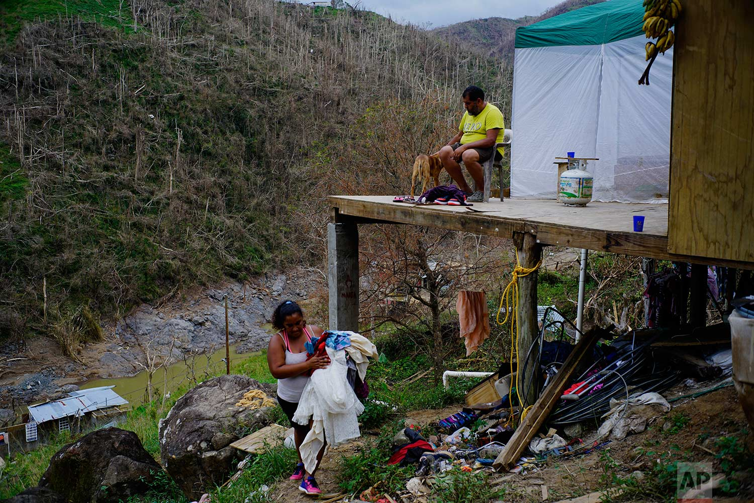 Yadira Sortre and William Fontan Quintero clean their house, destroyed by Hurricane Maria in in Morovis, Puerto Rico, Sunday, Oct. 1, 2017. (AP Photo/Ramon Espinosa)