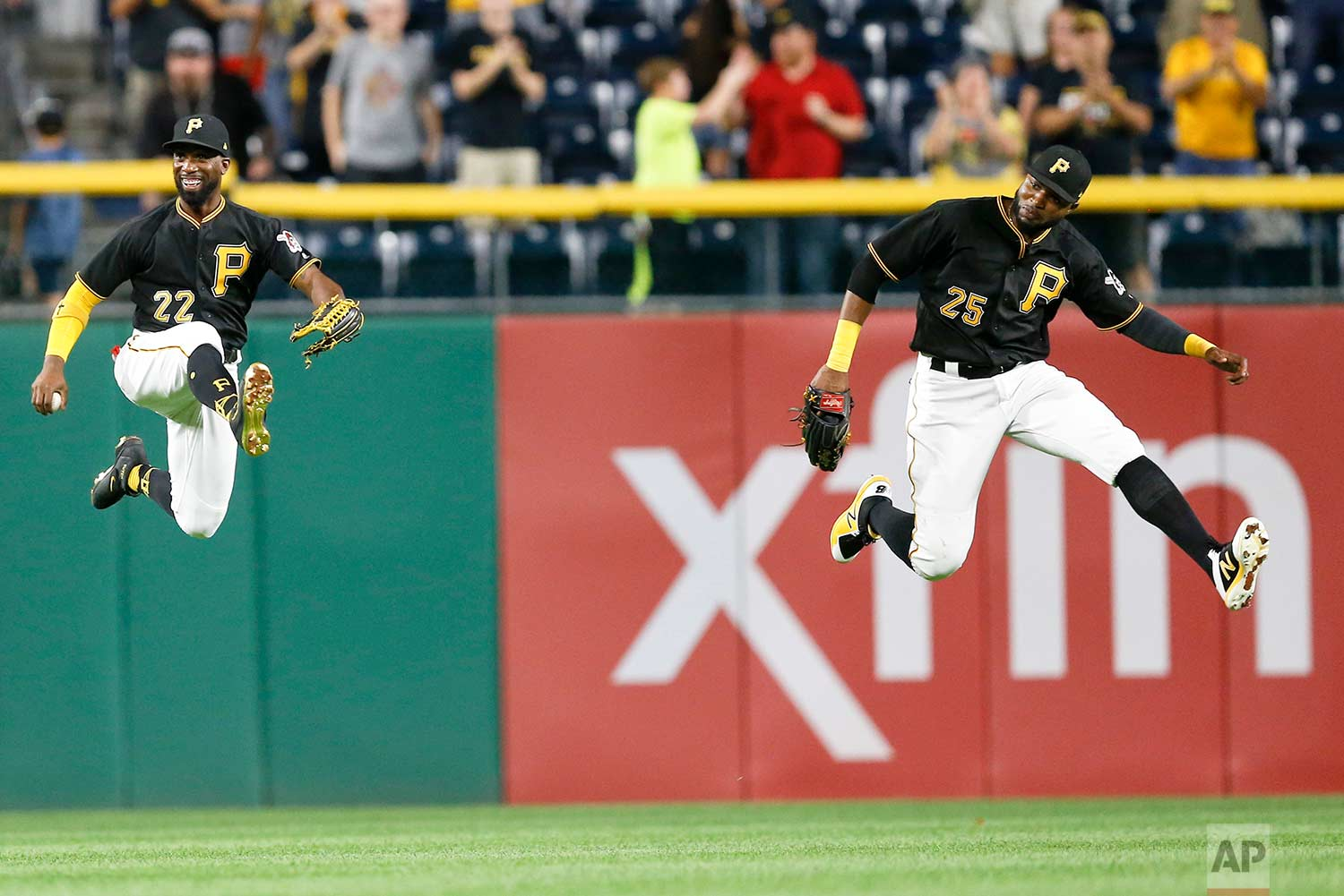 Pittsburgh Pirates center fielder Andrew McCutchen (22) and right fielder Gregory Polanco (25) leap in celebration after the Pirates defeated the Baltimore Orioles 5-3 in a baseball game, Wednesday, Sept. 27, 2017, in Pittsburgh. (AP Photo/Keith Srakocic)