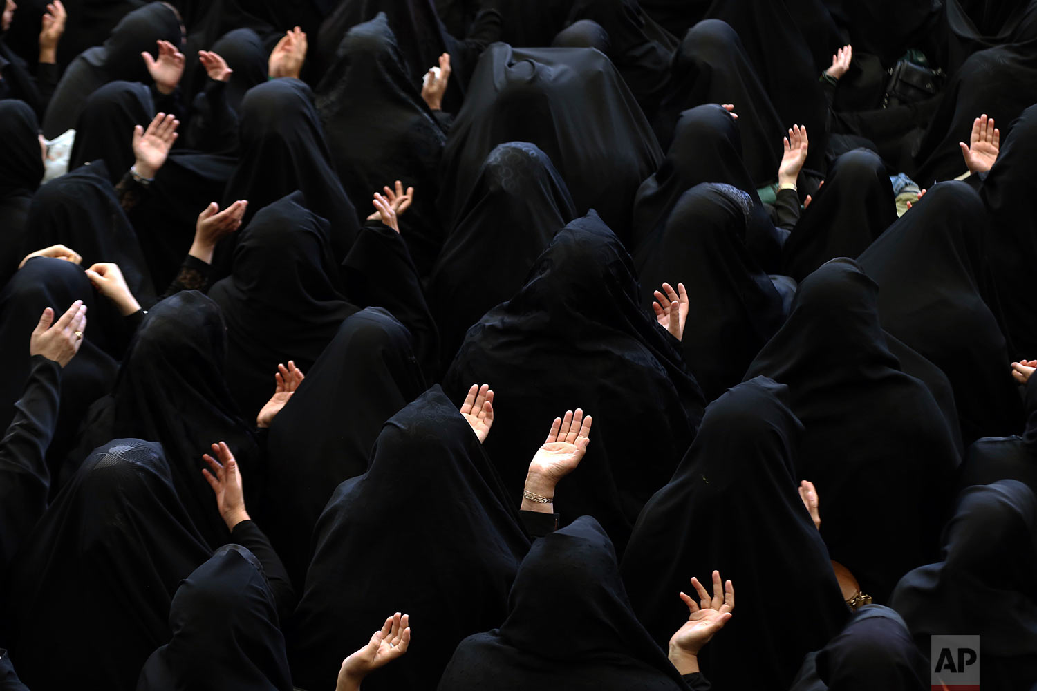 Iranian Shiite Muslim women mourn during a ceremony at Sadat Akhavi mosque in Tehran, Iran, Saturday, Sept. 30, 2017, a day prior to Ashoura, the death anniversary of 7th century Shiite Imam Hussein, the grandson of Prophet Muhammad, who was killed in a battle in Karbala in present-day Iraq. (AP Photo/Ebrahim Noroozi)