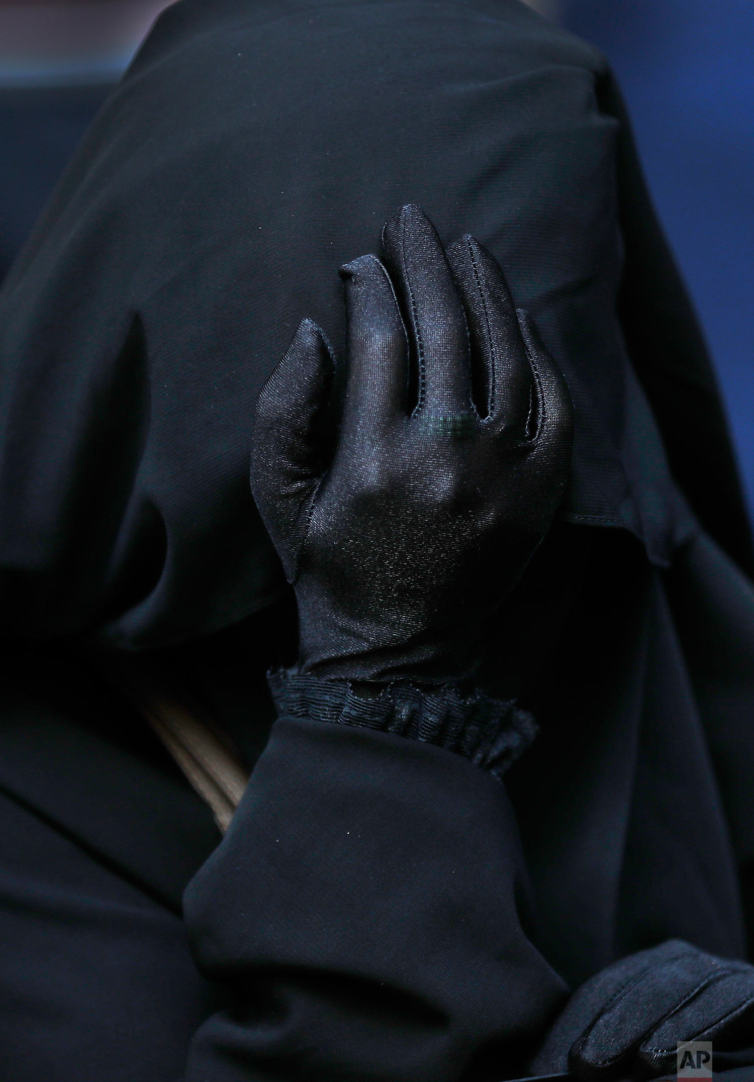 A veiled Lebanese woman supporter of a hardline Sunni cleric Ahmad al-Assir and 33 other militants who are standing trial, reacts during a protest outside the military tribunal, in Beirut, Lebanon,Thursday, Sept. 28, 2017. A military judge is scheduled to issue a verdict later in the day against Sheikh Ahmad al-Assir and 33 others on charges of fighting the Lebanese army in the southern city of Sidon in 2013. (AP Photo/Hussein Malla)