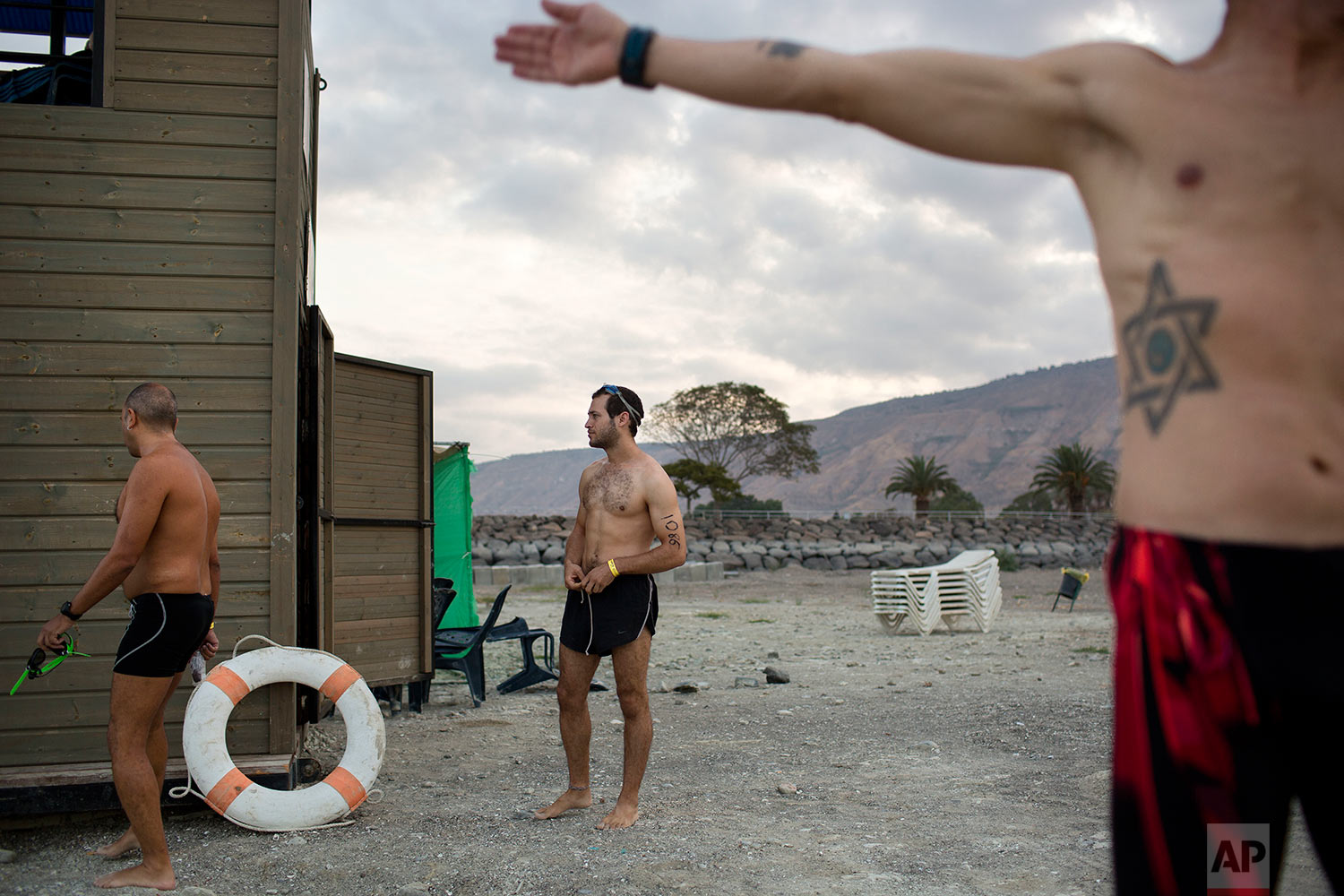 Swimmers participate in the annual Sea of Galilee swim, the oldest and largest popular swimming event, near Tiberias, northern Israel, Saturday, Sept. 16, 2017. (AP Photo/Oded Balilty)