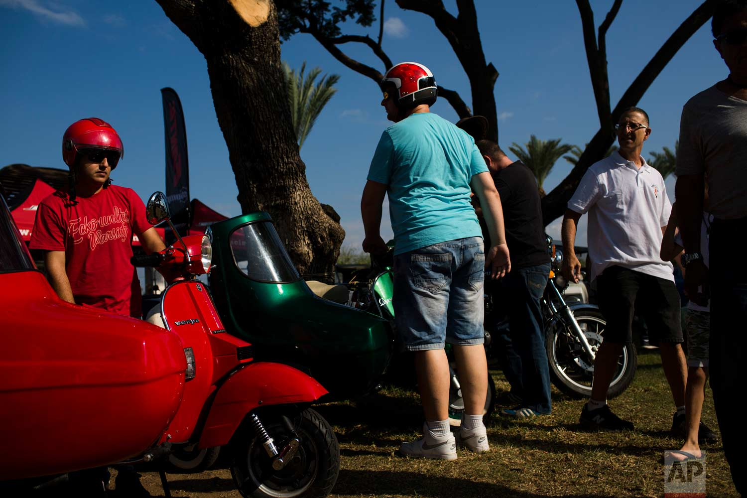 "People park their antique scooters during the 31st annual ""Five Club"" car collectors' meeting in Ramat Gan, Israel, Friday, Oct. 6, 2017. (AP Photo/Oded Balilty)"