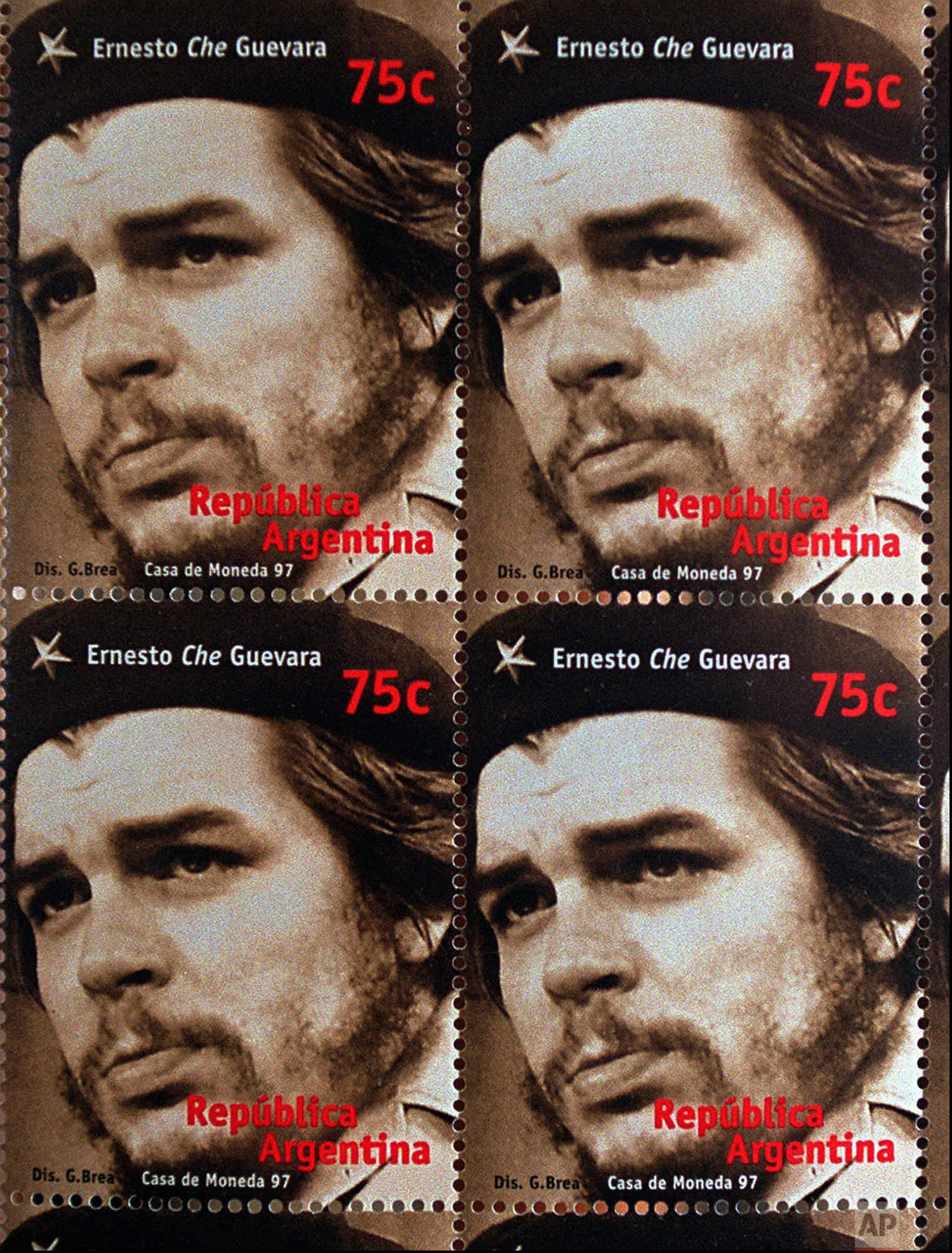 """This photo shows mail stamps issued by the recently-privatized Argentine postal service to commemorate the 30th anniversary of the death of Argentine guerrilla leader Ernesto """"Che"""" Guevara, executed by Bolivian army soldiers along with six fellow rebels 30 years ago. The 34 by 44 millimeter (1.3 by 1.7 inch) sepia-colored stamp which will go on sale Wednesday Oct. 8, 1997, shows a three quarters profile photo of Guevara taken by Cuban photographer Raul Corralvalera in 1967. (AP Photo/Daniel Muzio)"""