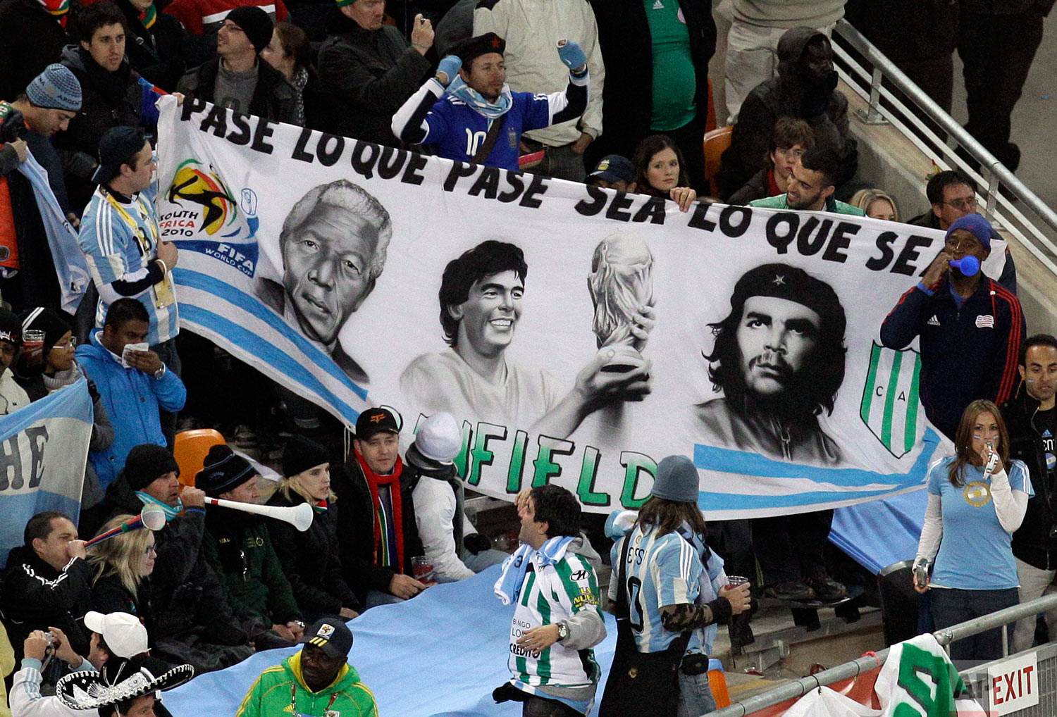 Argentina fans hold up a banner with images of former President Nelson Mandela, Diego Maradona and Che Guevara during the World Cup round of 16 soccer match between Argentina and Mexico at Soccer City in Johannesburg, South Africa, Sunday, June 27, 2010. Argentina won 3-1. (AP Photo/Themba Hadebe)