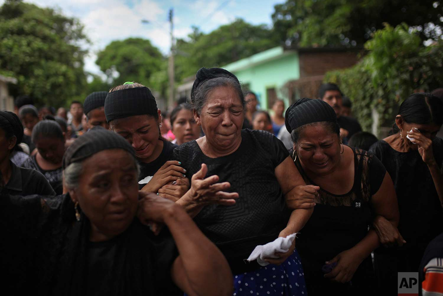 In this Sunday, Sept. 10, 2017 photo, relatives of 38-year-old earthquake victim, police officer Juan Jimenez Regalado, weep during his funeral in Juchitan, Oaxaca state, Mexico. (AP Photo/Felix Marquez)