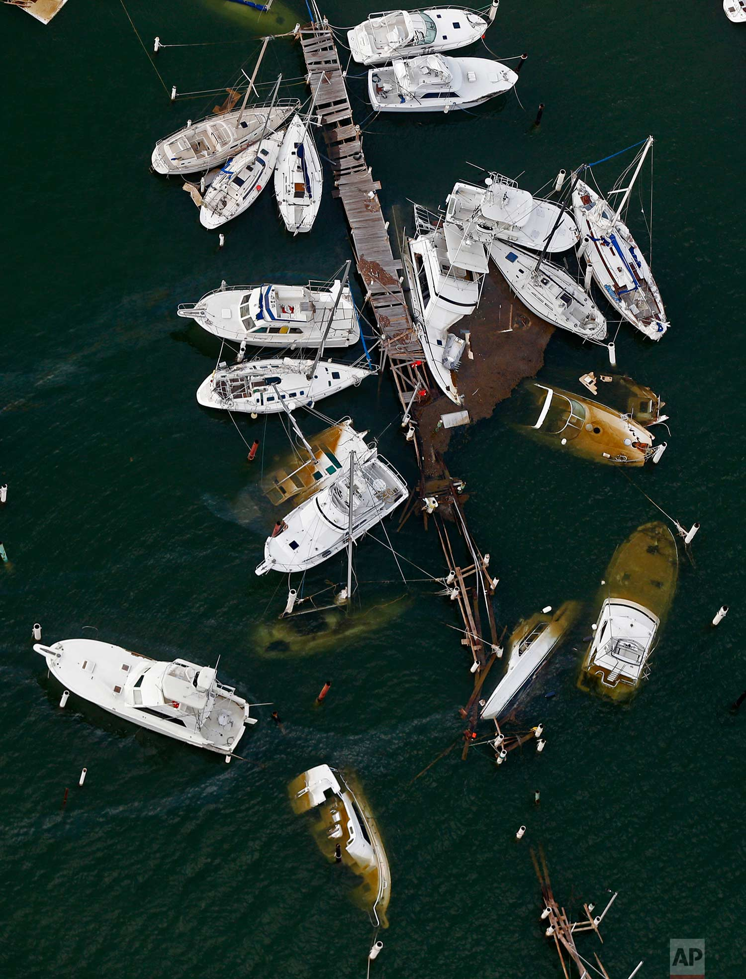 Damaged boats are seen in the aftermath of Hurricane Maria in Dorado, Puerto Rico, Thursday, Sept. 28, 2017. (AP Photo/Gerald Herbert)