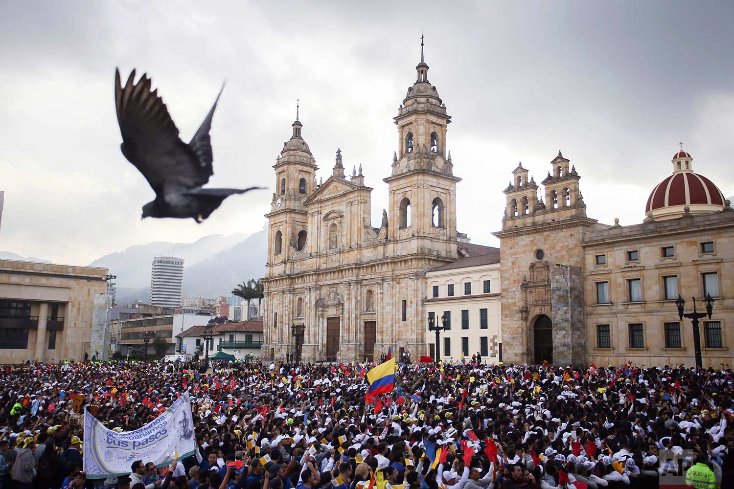 People gather in front of the Cathedral Primada in Simon Bolivar Square waiting for the arrival of Pope Francis in Bogota, Colombia, Thursday, Sept. 7, 2017. (AP Photo/Ivan Valencia)