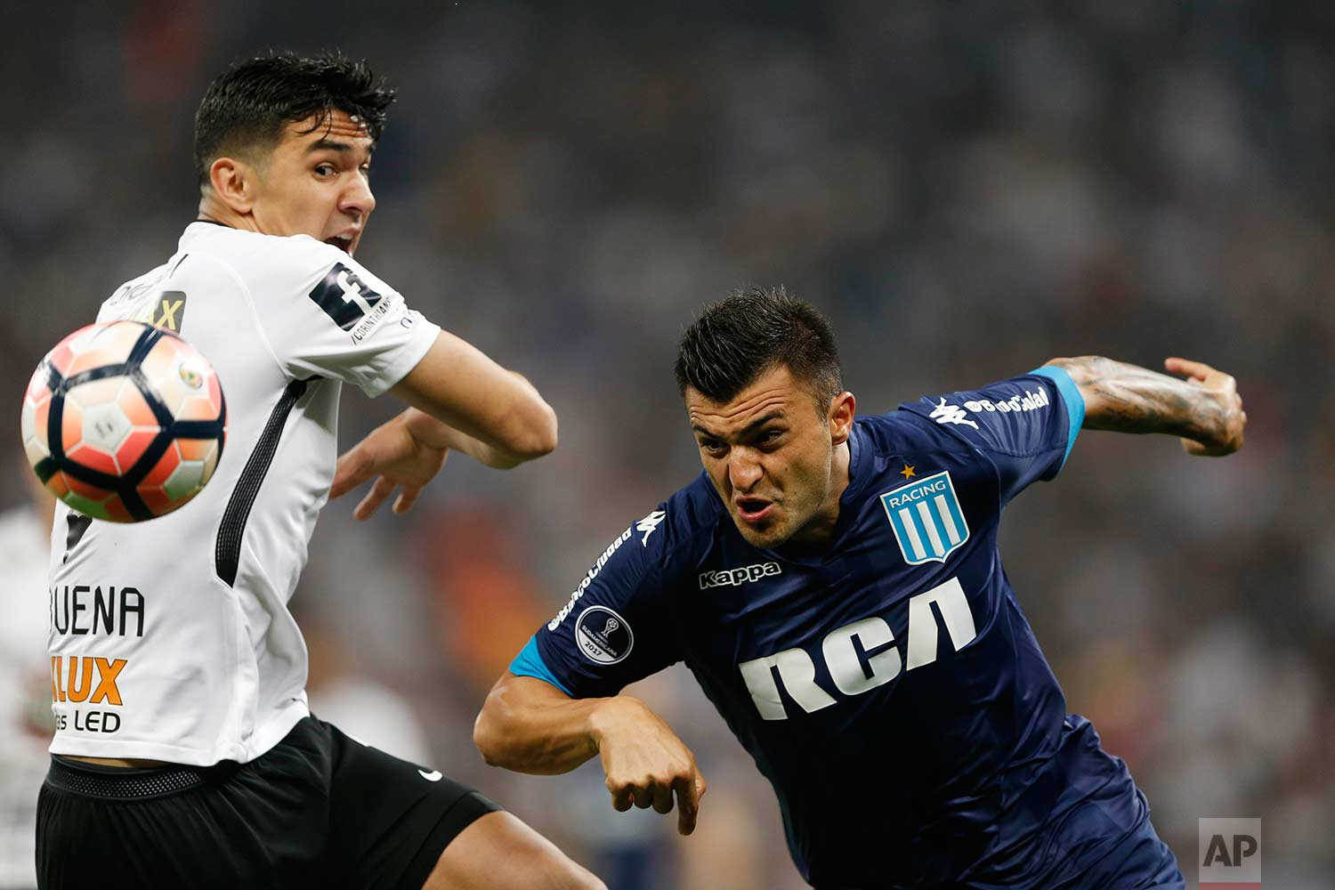 Fabian Balbuena of Brazil's Corinthians fights for the ball with Enrique Luis Triverio of Argentina's Racing Club, right, during a Copa Sudamericana soccer match in Sao Paulo, Brazil, Wednesday, Sept. 13, 2017. (AP Photo/Nelson Antoine)