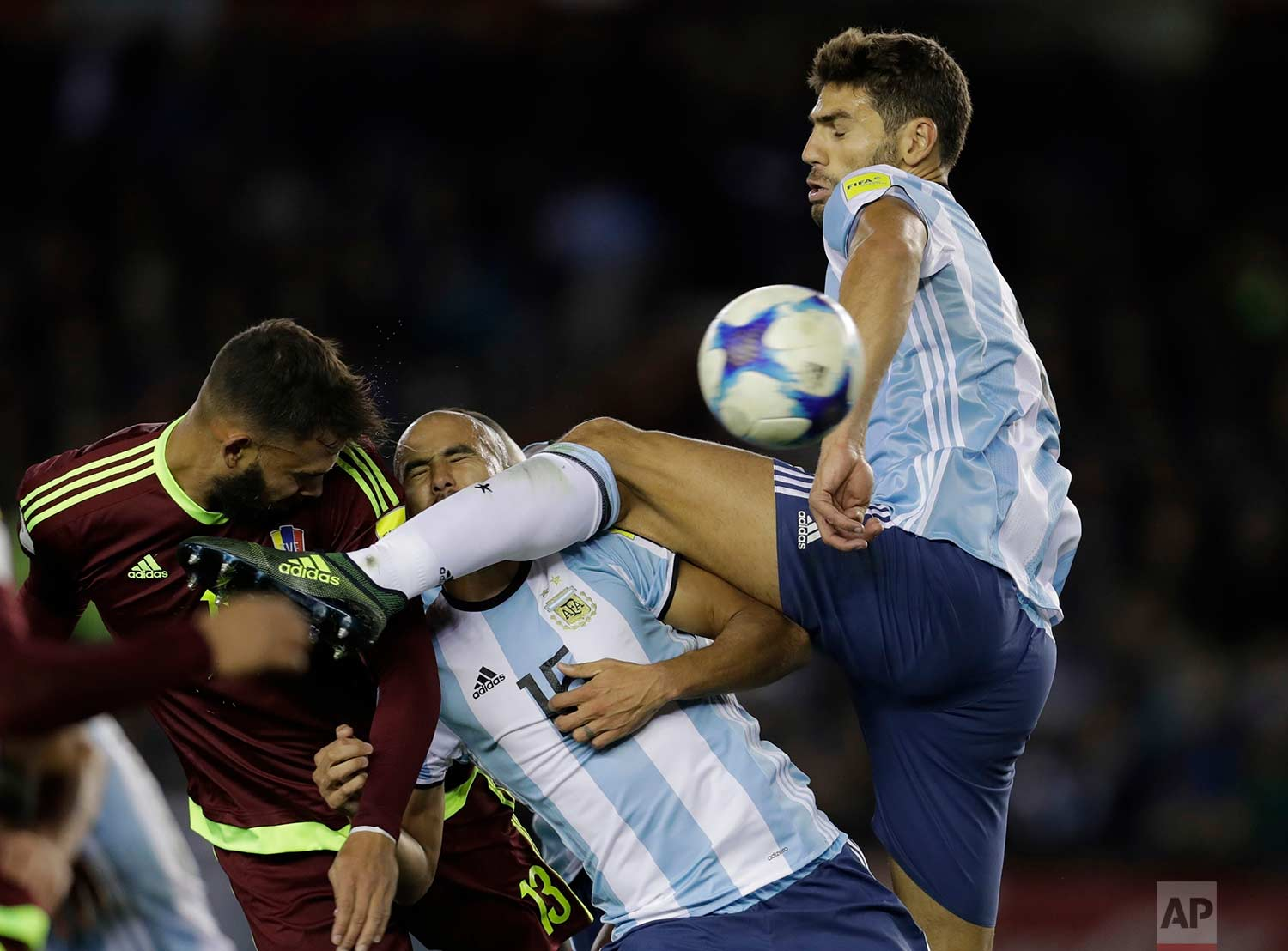 In this Tuesday, Sept. 5, 2017 photo, Venezuela's Jhon Chancellor, left, clears a ball beside Argentina's Guido Pizarro, center, and Federico Fazio during a 2018 World Cup qualifying soccer match in Buenos Aires, Argentina. (AP Photo/Victor R. Caivano)