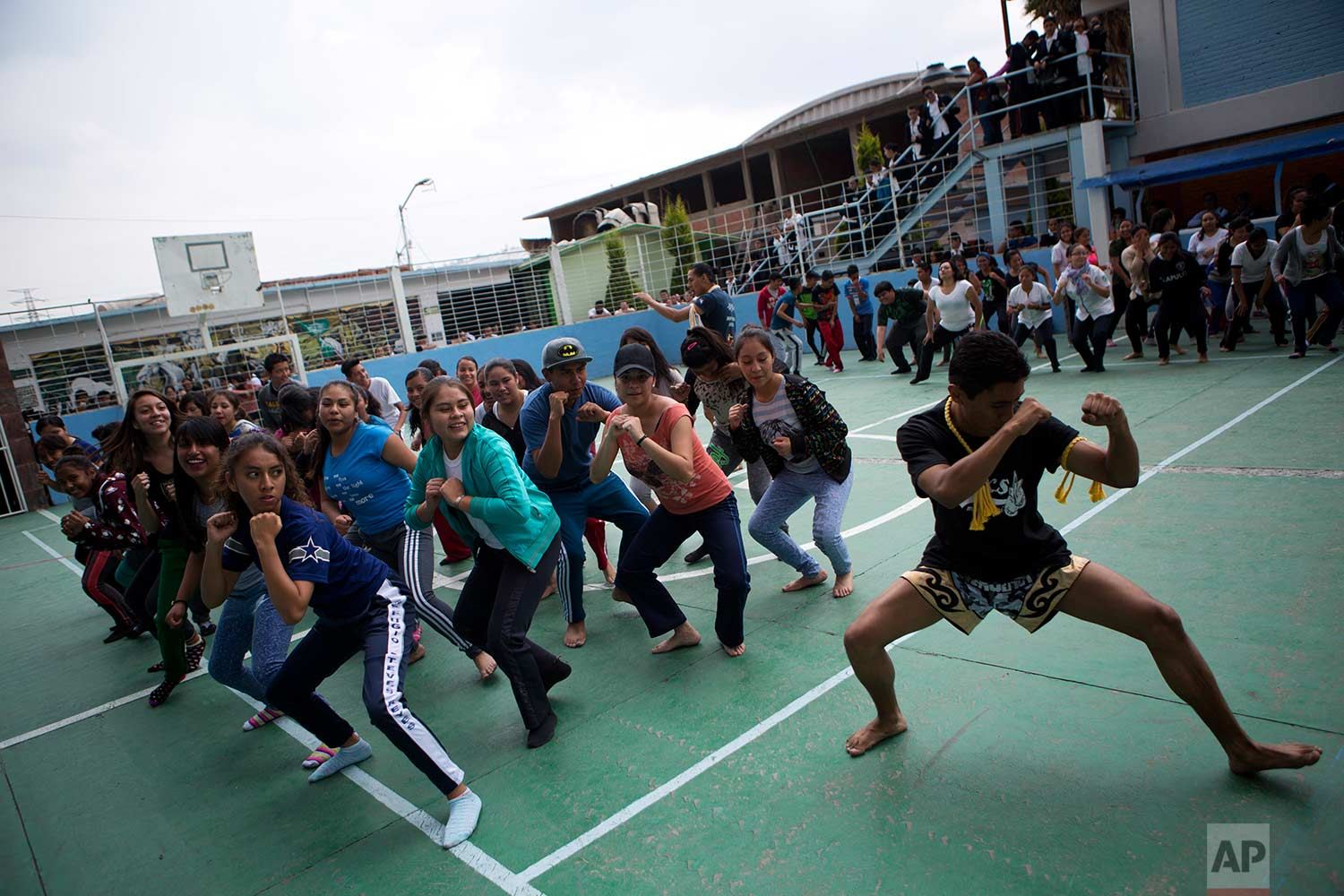 In this Aug. 25, 2017 photo, Muay Thai practitioners lead mostly female students at a nursing school in a self-defense workshop in Nezahualcoyotl, Mexico state.(AP Photo/Rebecca Blackwell)