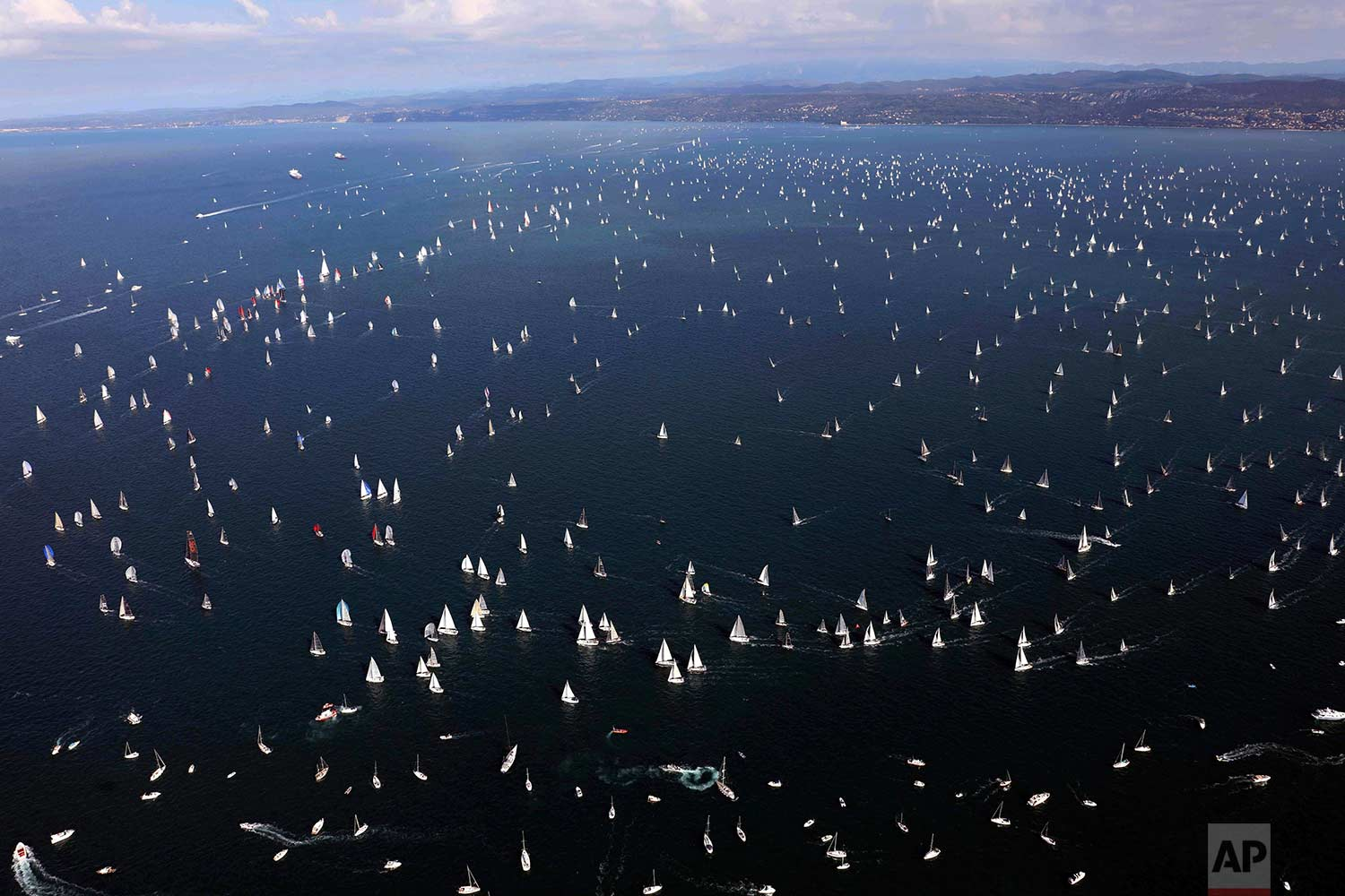 "Sailboats participate in the 49nd edition of the traditional ""Barcolana"" regatta in the Gulf of Trieste, northeastern Italy, Sunday, Oct. 8, 2017. (AP Photo/Paolo Giovannini)"