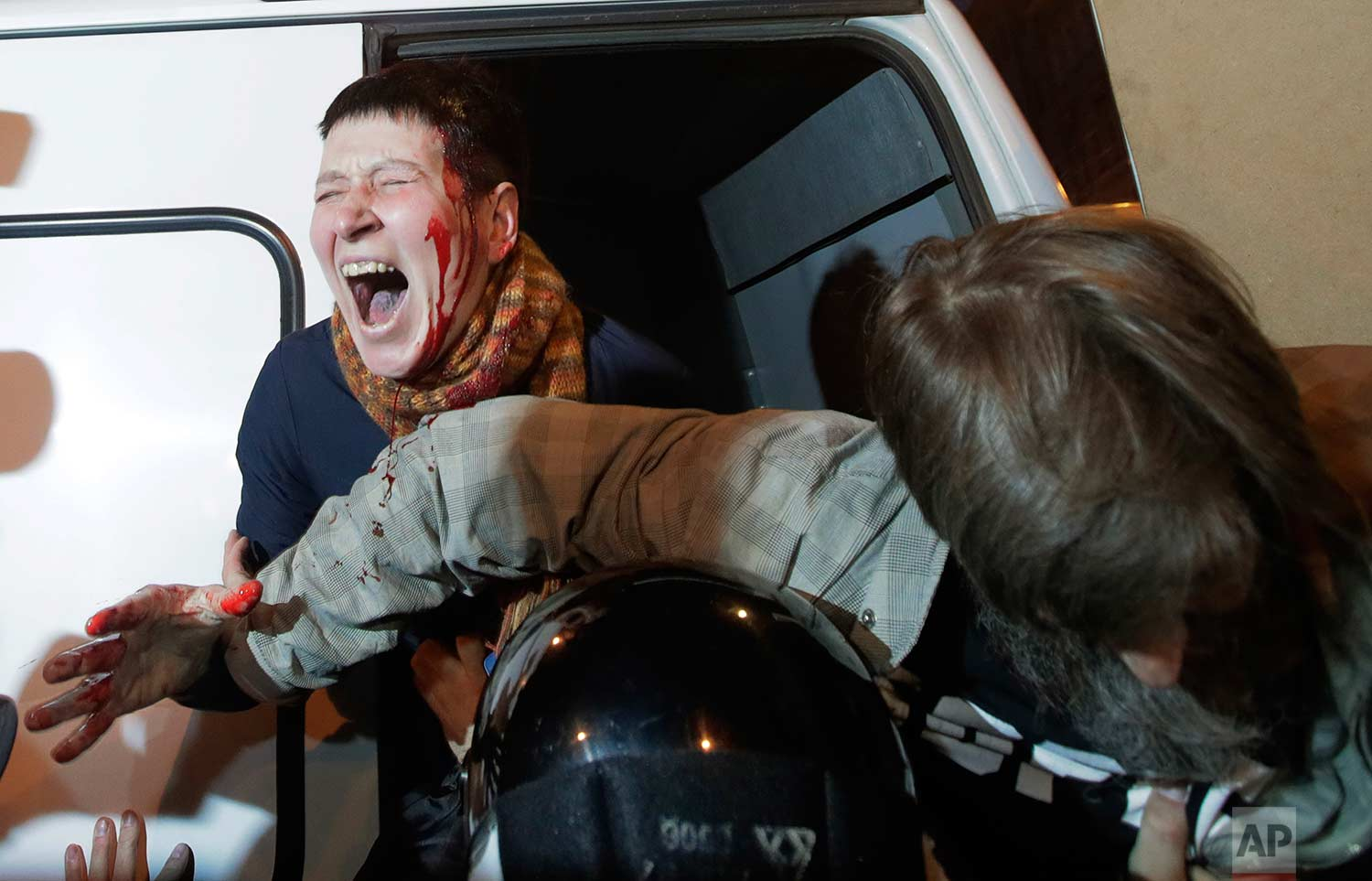 Riot police officers detain protesters during a rally in St. Petersburg, Russia on Saturday, Oct. 7, 2017. (AP Photo/Dmitri Lovetsky)