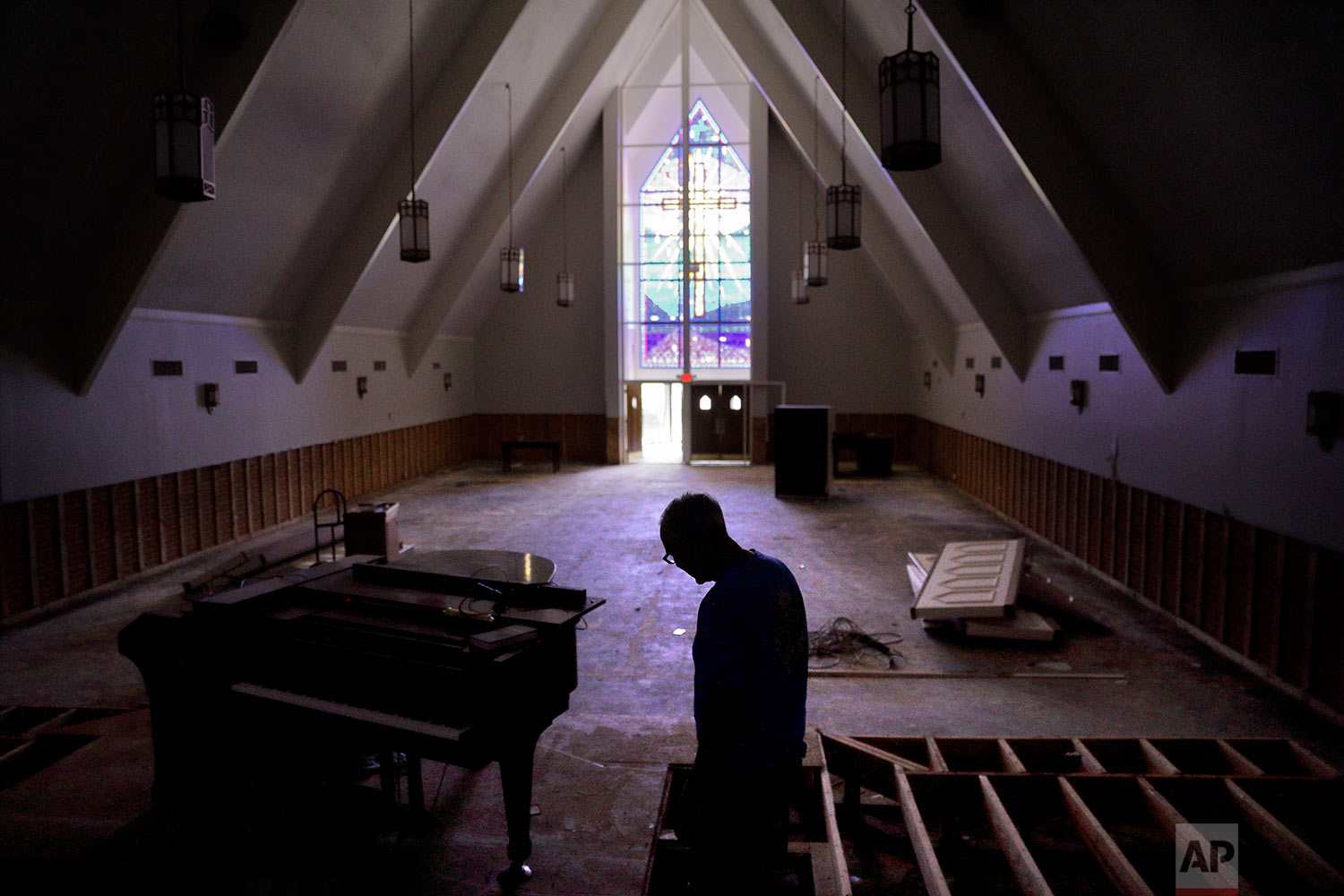Wayne Christopher walks through the Hurricane Harvey-damaged sanctuary of the Memorial Baptist Church in Port Arthur, Texas, Monday, Sept. 25, 2017. He had attended the church for his whole life. In the weeks since Hurricane Harvey devastated Jefferson County, Texas, and as other monstrous storms pummeled Florida and Puerto Rico, some here found themselves in quiet moments pondering what has become some of the most polarizing questions in American political discourse: have human beings altered the earth so profoundly it is making bad storms more brutal? And what should we do about it now? (AP Photo/David Goldman)