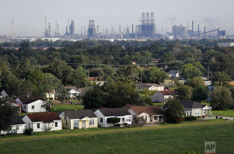 A residential neighborhood sits next to an oil refinery in Port Arthur, Texas, Thursday, Sept. 28, 2017. (AP Photo/David Goldman)