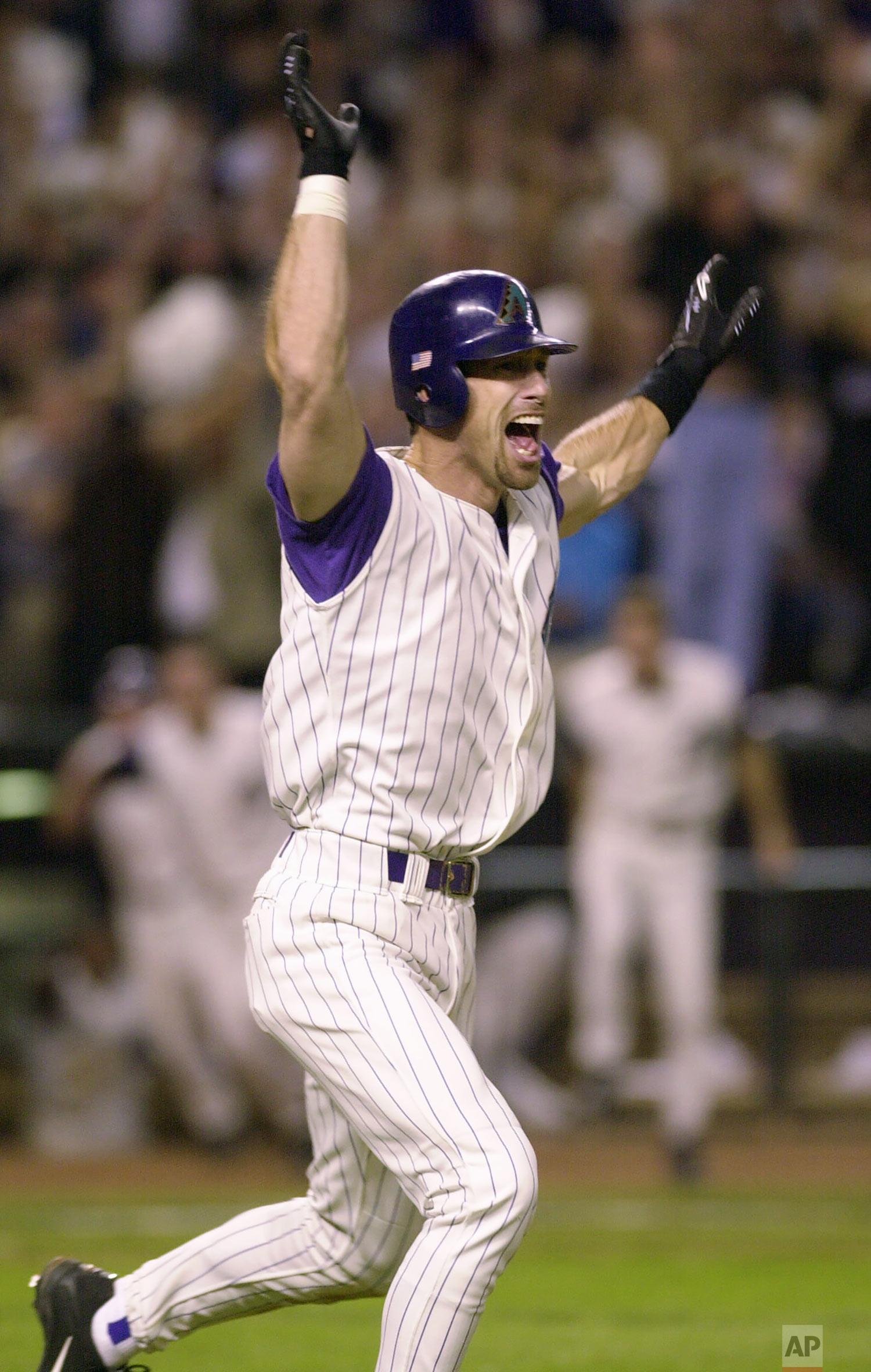 Arizona Diamondbacks' Luis Gonzalez celebrates driving in the winning run in the ninth inning of Game 7 of the World Series against the New York Yankees Sunday, Nov. 4, 2001, at Bank One Ballpark in Phoenix. (AP Photo/John Bazemore)