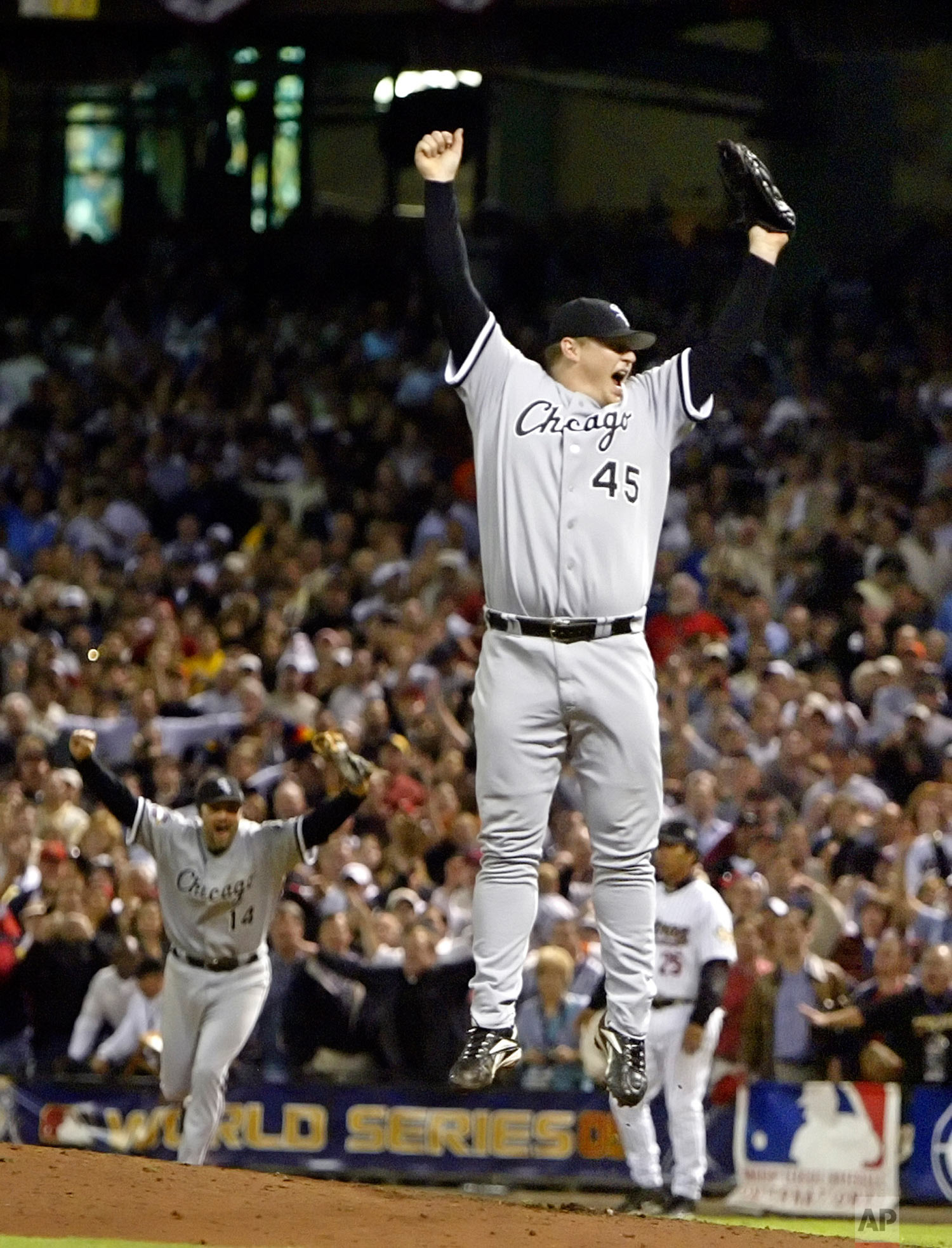 Chicago White Sox pitcher Bobby Jenks (45) and first baseman Paul Konerko (14) start the celebration as Chicago beats the Houston Astros 1-0 to win the World Series Wednesday, Oct. 26, 2005, in Houston. The White Sox won their first World Series since 1917 by sweeping the Astros 4-0 in the best-of-seven games series. (AP Photo/Eric Gay)