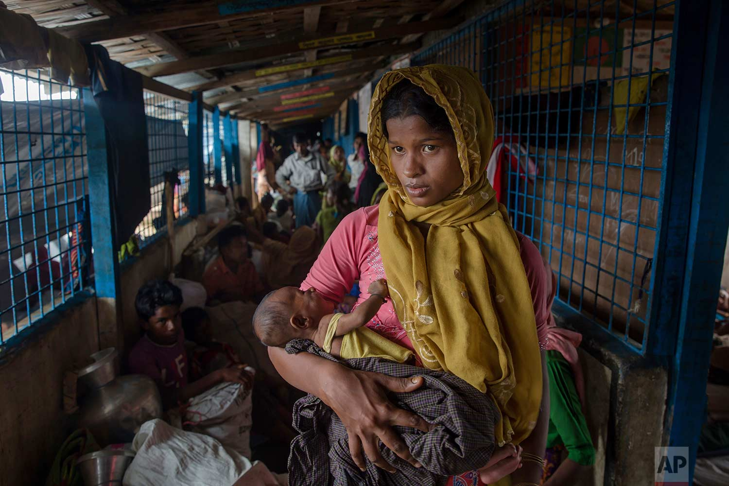 A Rohingya Muslim woman Setara Begum, who crossed over from Myanmar into Bangladesh, holds her 45-day-old son Mohammad Hussain in a dormitory of a school in Kutupalong refugee camp, Bangladesh, Friday, Oct. 20, 2017. (AP Photo/Dar Yasin)