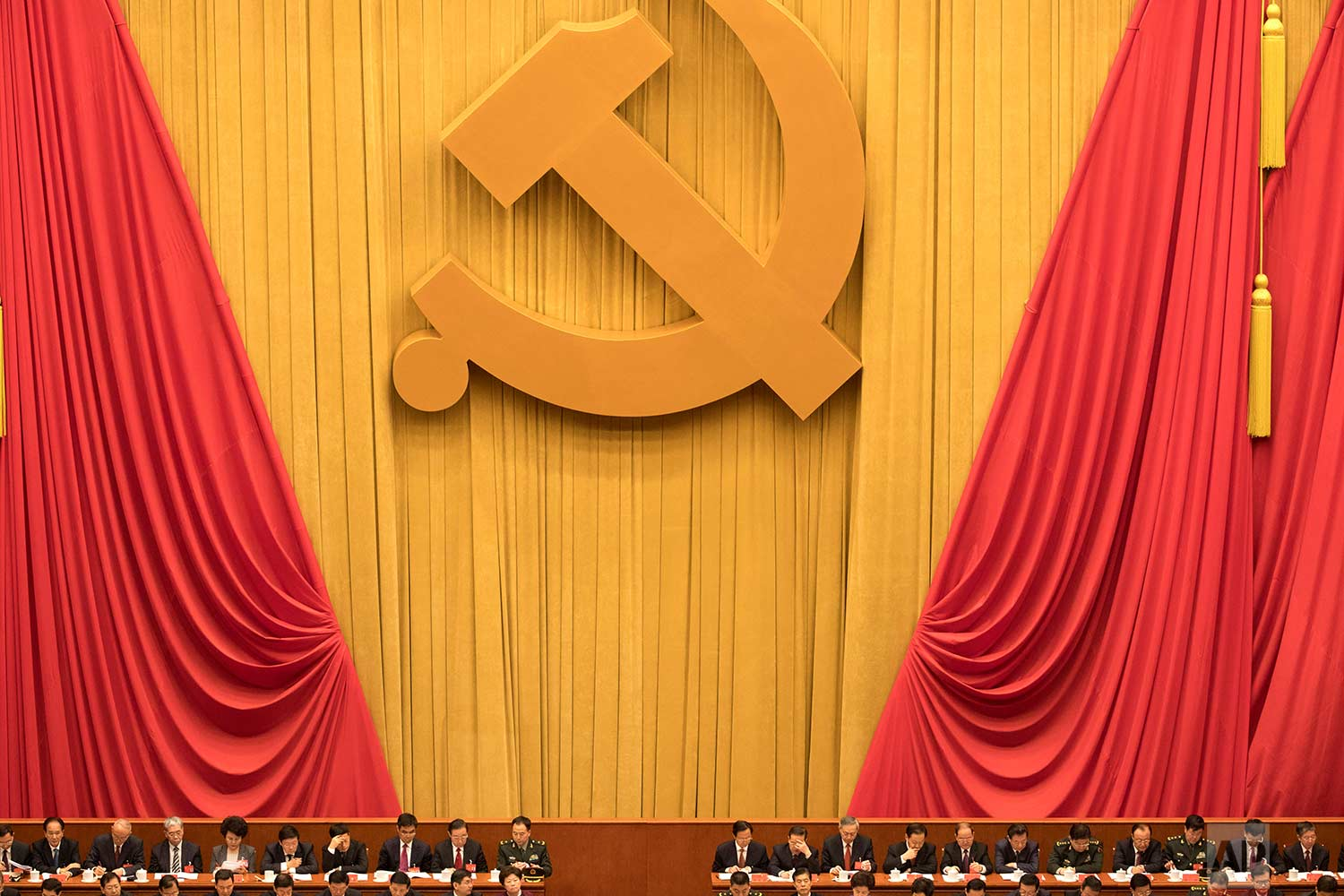 Chinese communists party cadres attend the opening ceremony of the 19th Party Congress held at the Great Hall of the People in Beijing, China, Wednesday, Oct. 18, 2017. (AP Photo/Ng Han Guan)