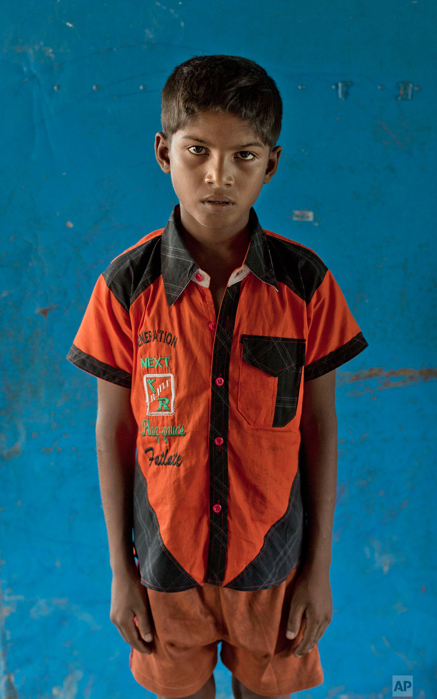 In this Oct. 1, 2017, photo nine-year-old Abdul Rakhim, from Myanmar's Moidaung village, poses for a photograph at a transit shelter at Kutupalong camp for newly arrived Rohingya refugees in Bangladesh. Abdul's mother drowned when the boat she was traveling in along with her four sons capsized on Sept. 29. The brothers said their father was shot and killed by the Myanmar army. (AP Photo/Gemunu Amarasinghe)