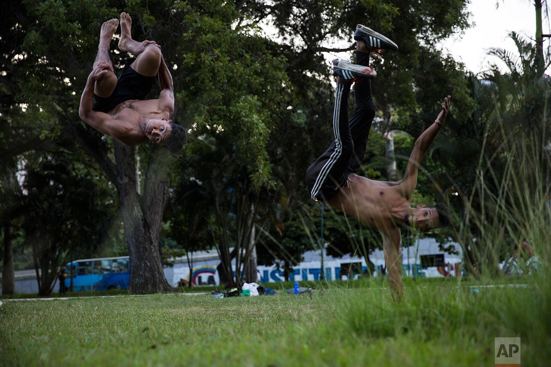 Alfredo Lopez, 22, left, and Cesar Munoz, practice parkour at Paseo Los Proceres in Caracas, Venezuela, Sunday, Oct. 22, 2017. (AP Photo/Rodrigo Abd)