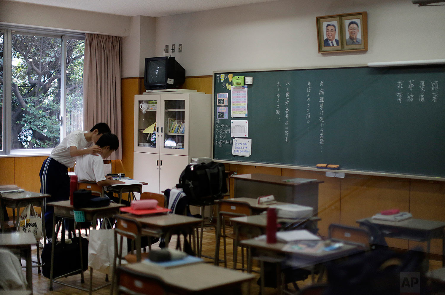 In this Sept. 26, 2017, photo, students study in a classroom at a senior high school in Tokyo.  (AP Photo/Eugene Hoshiko)
