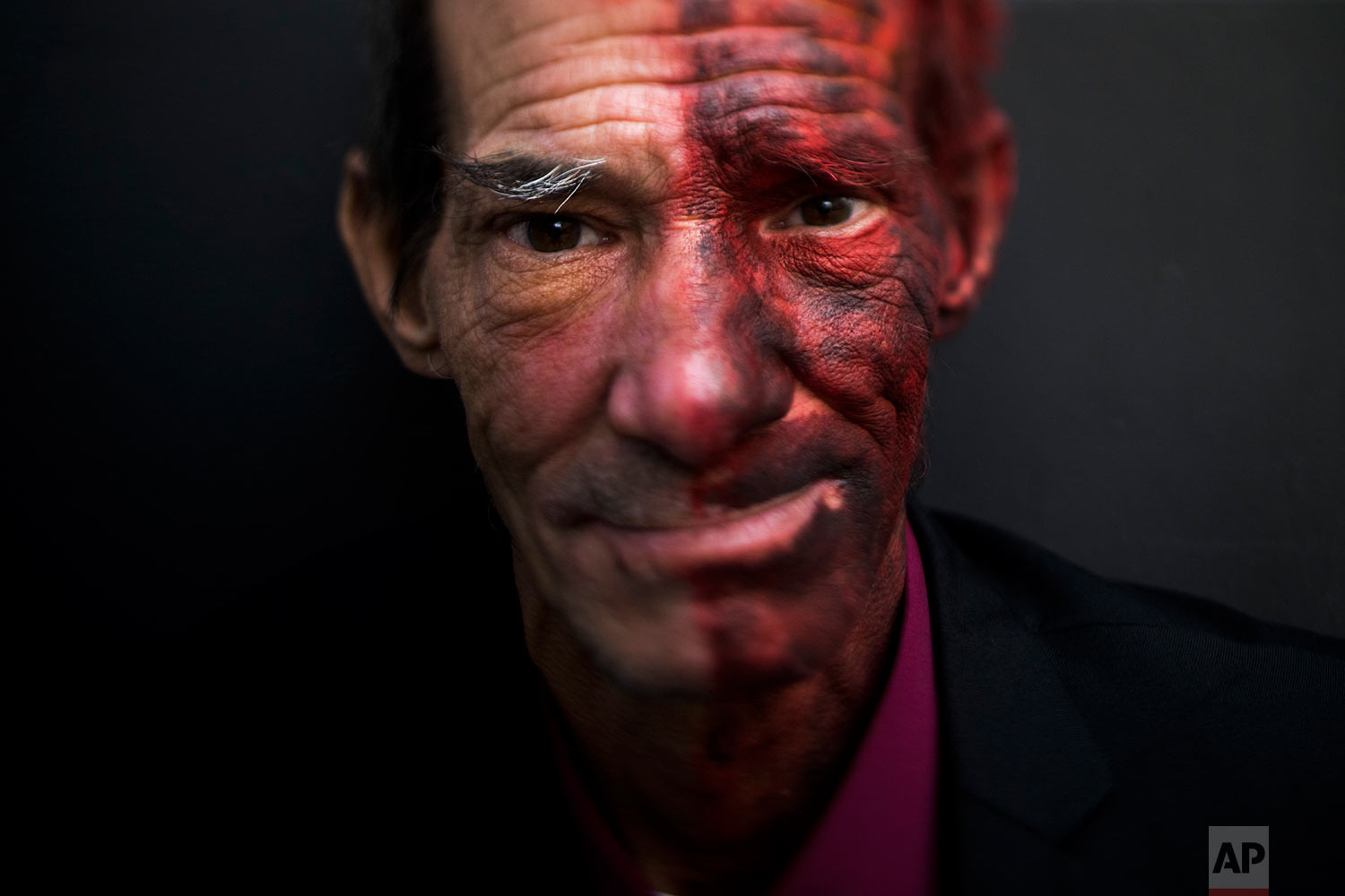 """James Harris, 54, pauses for photos Tuesday, Oct. 3, 2017, in Los Angeles. """"I'm currently dressed up as Two-Face. I'm tired of panhandling. I'm not making money as a panhandler when I need food and supplies,"""" said Harris who has been homeless over a year. (AP Photo/Jae C. Hong)"""