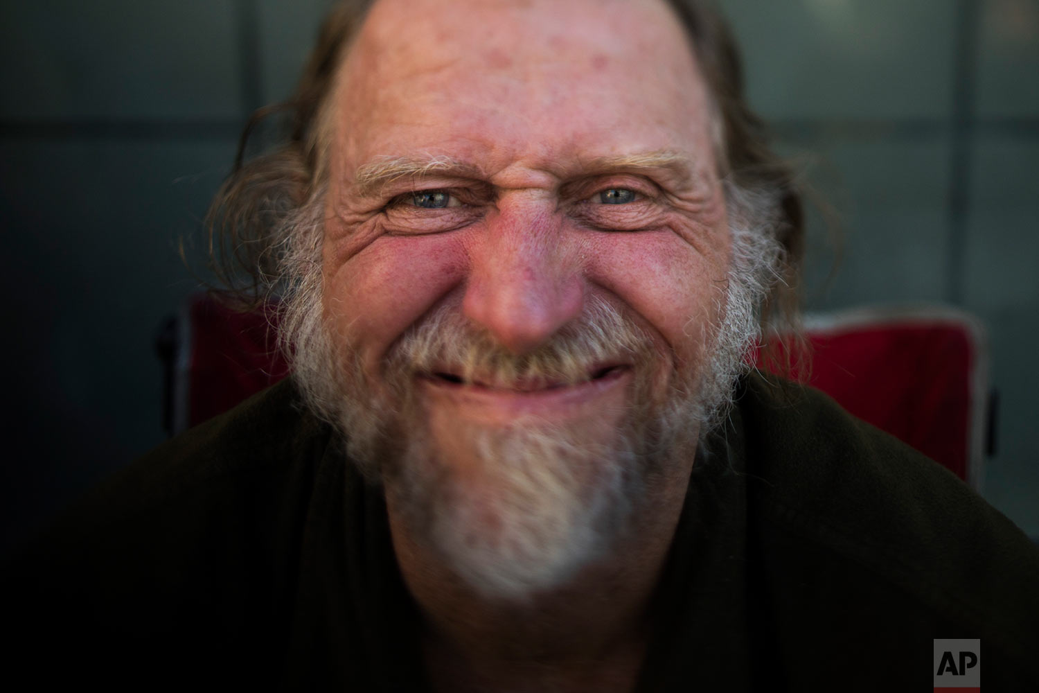 Barry Warren, 52, pauses for photos Wednesday, Sept. 27, 2017, in Seattle. Warren has been homeless his entire adult life. After about 20 years without a home in California, he moved to Seattle, where the benefits are better and life on the street is safer. (AP Photo/Jae C. Hong)