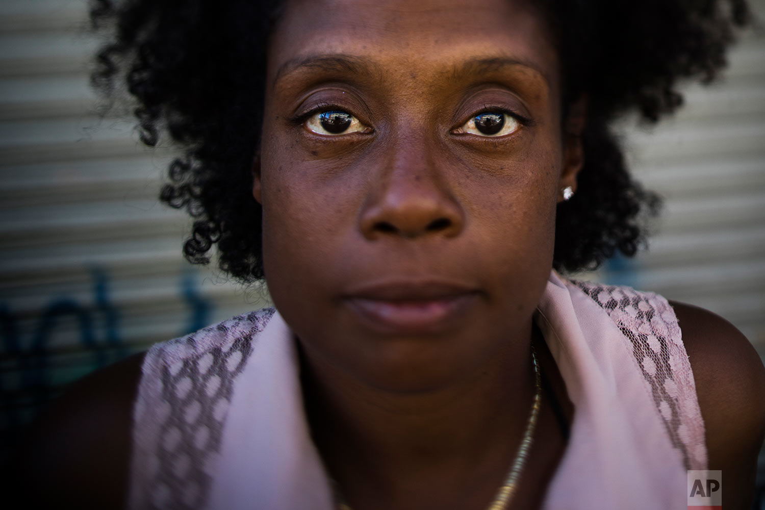 Dolores Epps, 41, pauses for photos Thursday, Oct. 26, 2017, in Los Angeles. Epps, a mother of two children who has been homeless for five years, does hair for a living and wants to open her own mission one day. (AP Photo/Jae C. Hong)