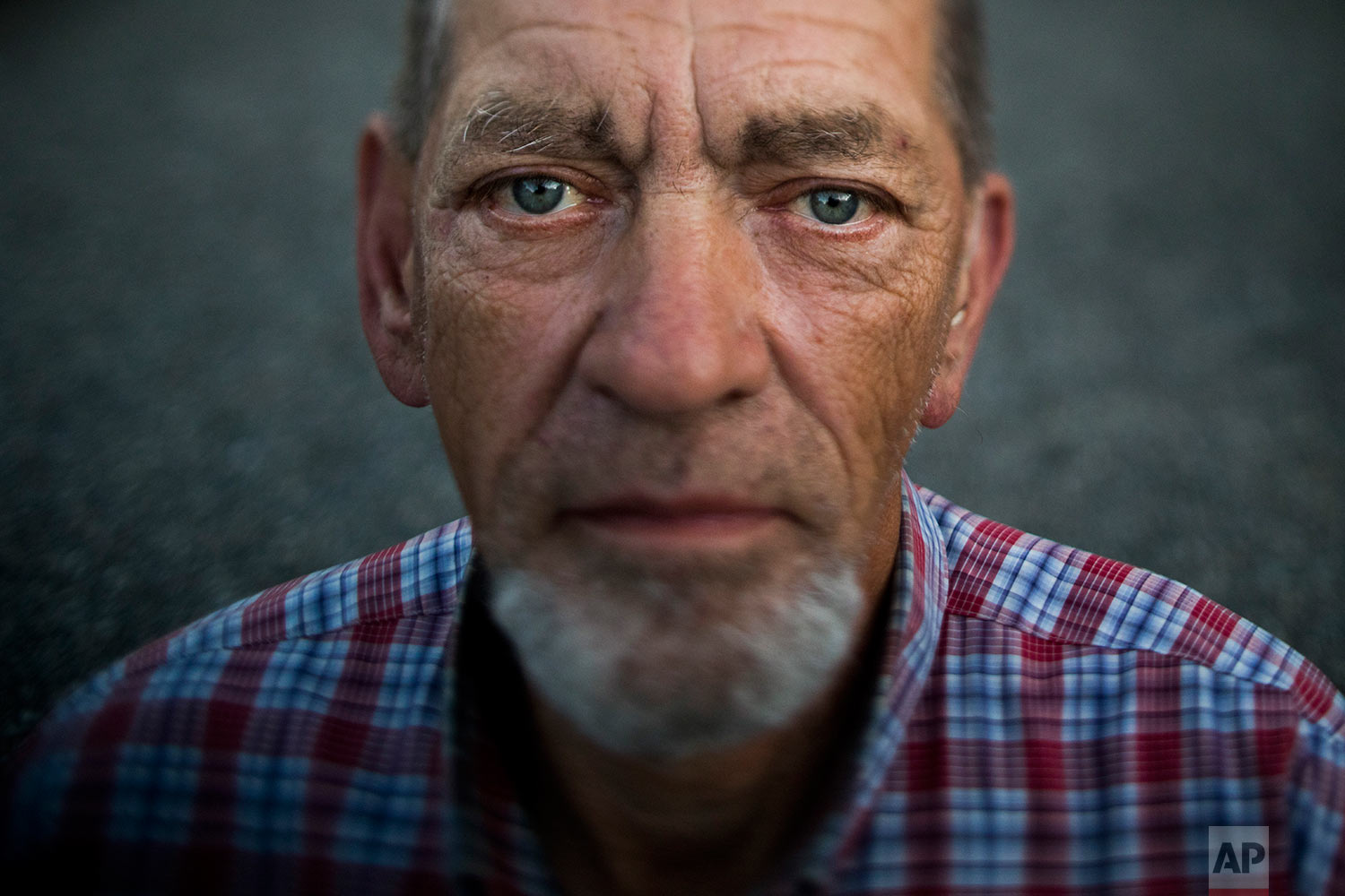 """Robert Irwin, 72, pauses for photos at Camp Second Chance, a city-sanctioned homeless encampment, Tuesday, Sept. 26, 2017, in Seattle. Irwin said he is planning a trip to Michigan to see his older sister. """"I have my own SUV, Chevy Trailblazer. I want to go in March. It will be my last trip."""" (AP Photo/Jae C. Hong)"""