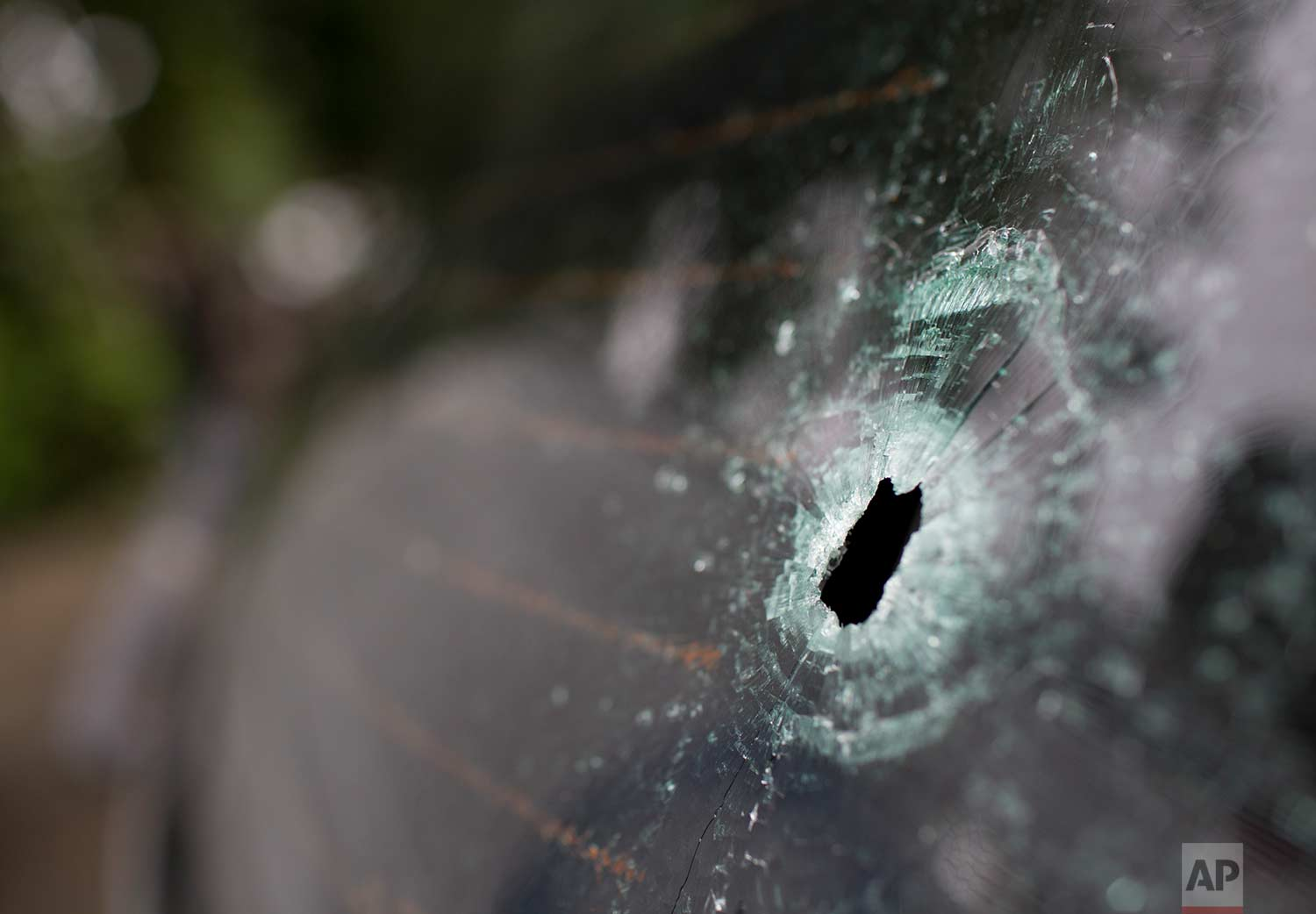 A bullet hole scars the back window of the car in which a Spanish tourist was shot dead by military police, at a police station in Rio de Janeiro, Brazil, Tuesday, Oct. 24, 2017. (AP Photo/Silvia Izquierdo)