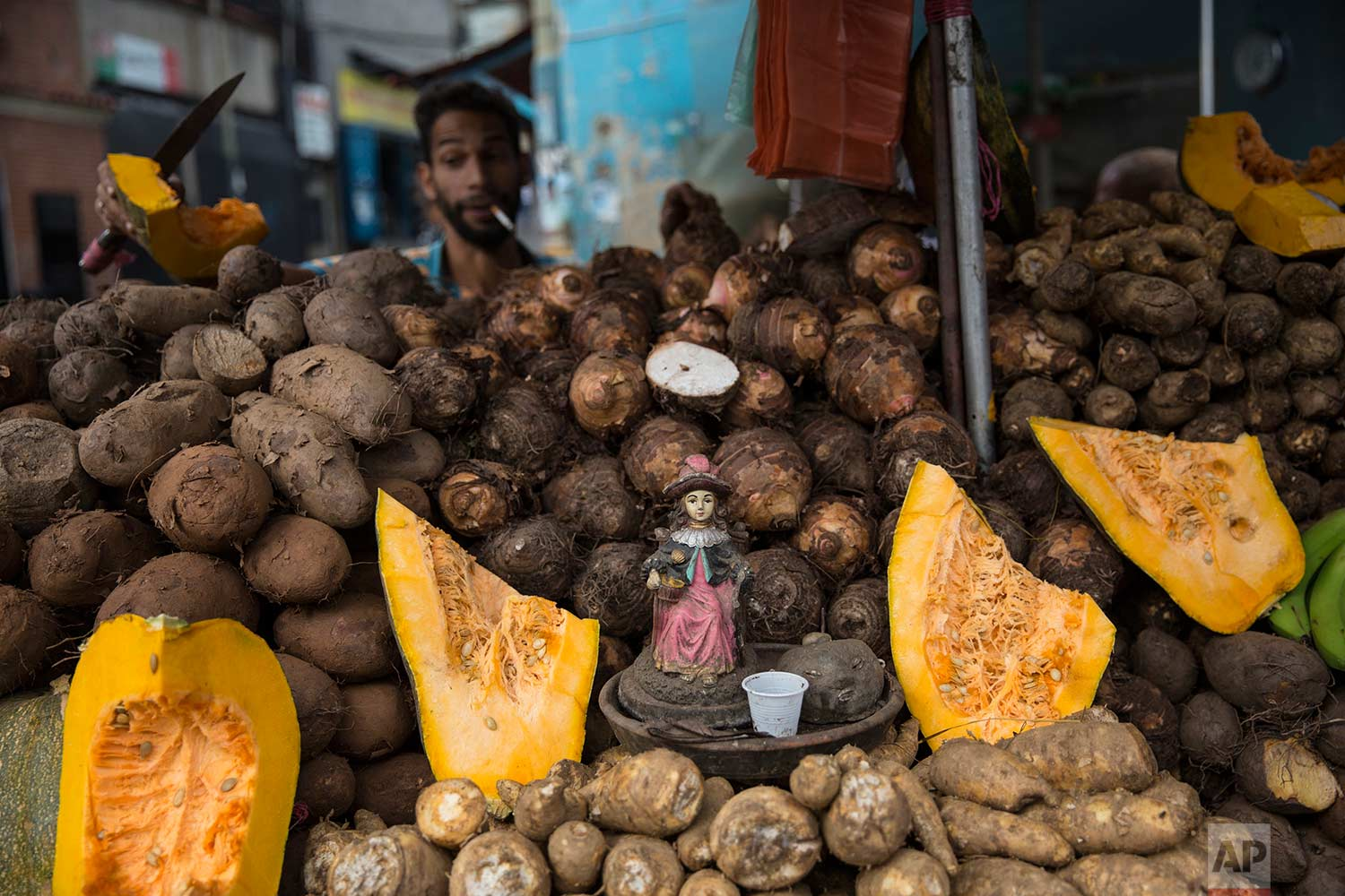 """A figurine of the """"Nino de Atoche"""" is displayed in a stand at a street market in Caracas, Venezuela, Friday, Oct. 27, 2017. (AP Photo/Rodrigo Abd)"""