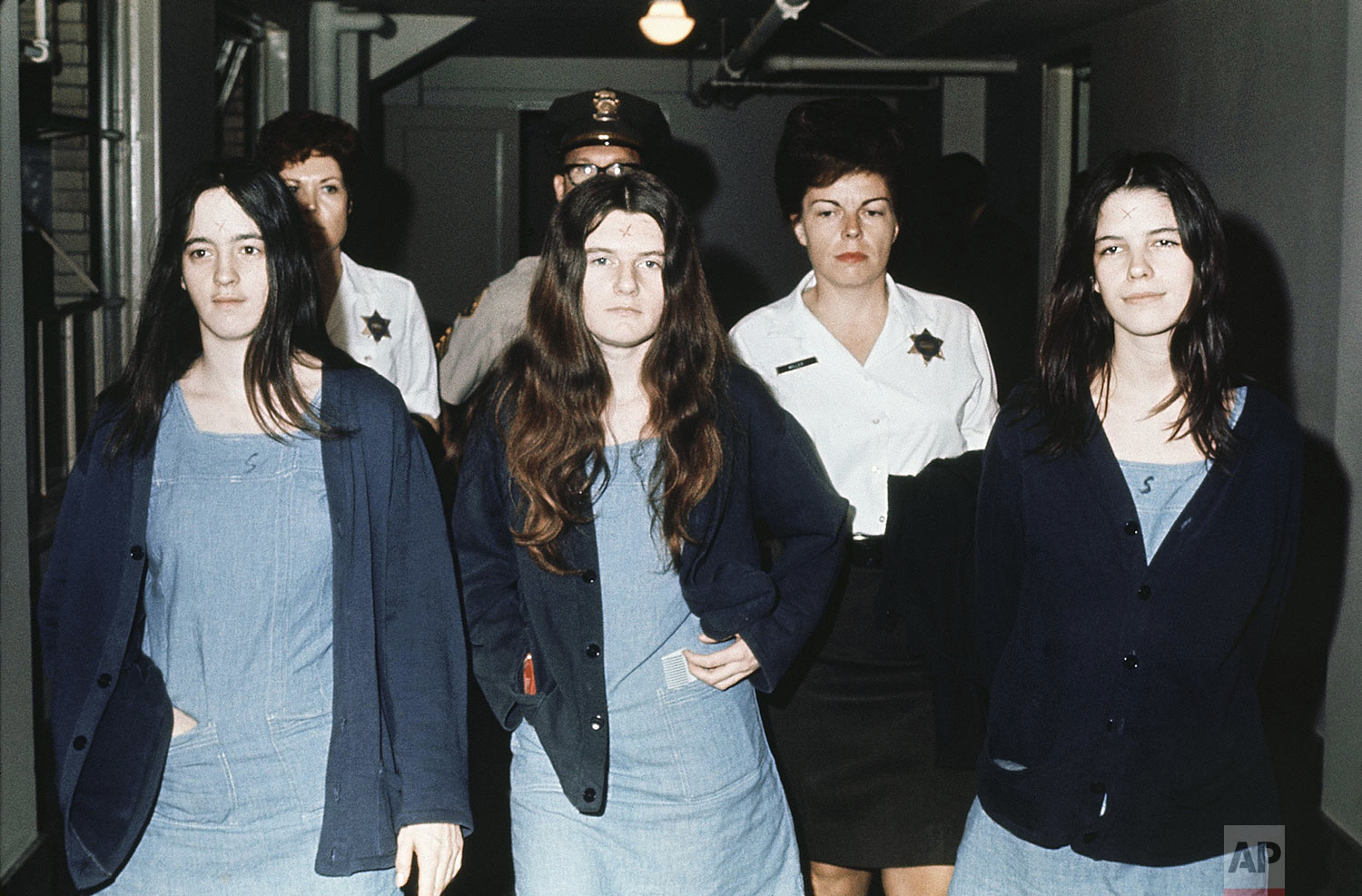 Three female defendants in the Manson court case are shown, from left to right: Susan Atkins, Patricia Krenwinkel, Leslie Van Houten, March 29 , 1971 as they return to court to hear the penalty ending a nine-month trial in the Tate-LaBianca murders of August 1969. All three, plus Charles Manson, were decreed the death sentence in the gas chamber. (AP Photo)