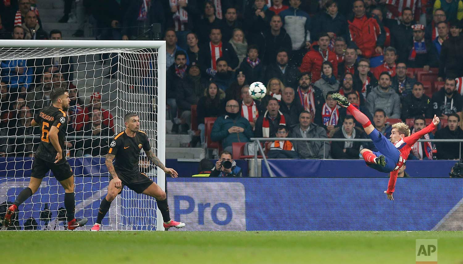 Atletico's Antoine Griezmann shoots to score his side's opening goal during a Champions League group C soccer match between Atletico Madrid and Roma at the Wanda Metropolitano stadium in Madrid, Wednesday, Nov. 22, 2017. (AP Photo/Paul White)