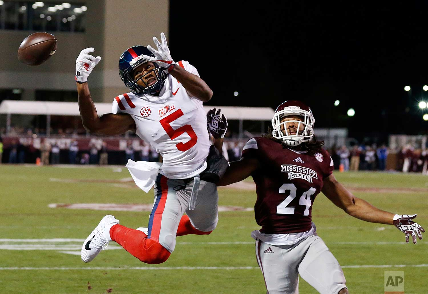 Mississippi wide receiver DaMarkus Lodge (5) cannot catch a first-half pass while Mississippi State defensive back Chris Rayford (24) defends during an NCAA college football game in Starkville, Miss., Thursday, Nov. 23, 2017. Mississippi won 31-28. (AP Photo/Rogelio V. Solis)