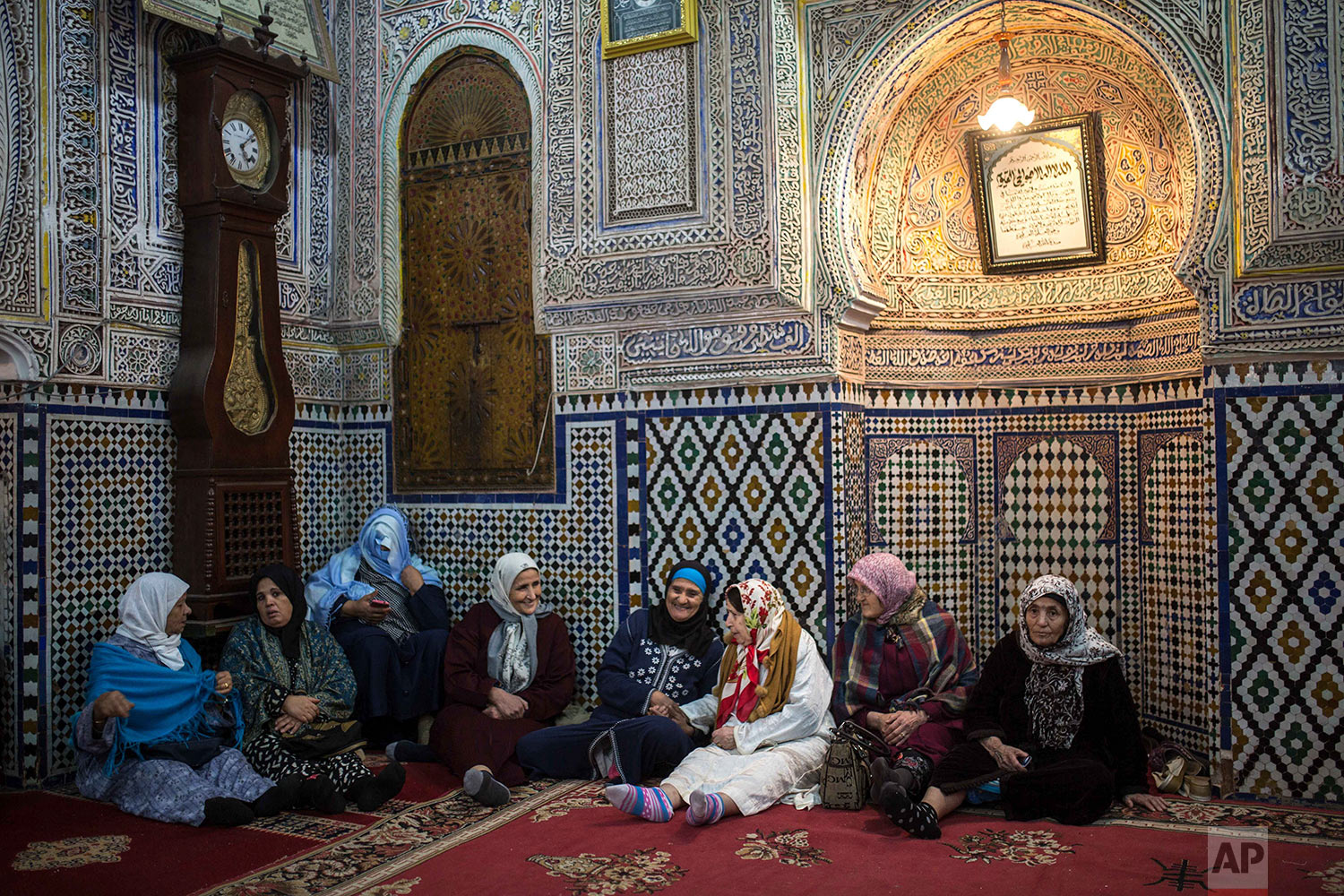 In this Thursday Nov. 30, 2017 photo, women gather at a Sufi shrine as they celebrate the birth anniversary of Prophet Muhammad, in Sale, near Rabat, Morocco. A large parade with historic roots takes place in the Moroccan city of Sale each year to mark the birth of Prophet Muhammad, an occasion Muslims around the world observe as Mawlid an-Nabi. (AP Photo/Mosa'ab Elshamy)