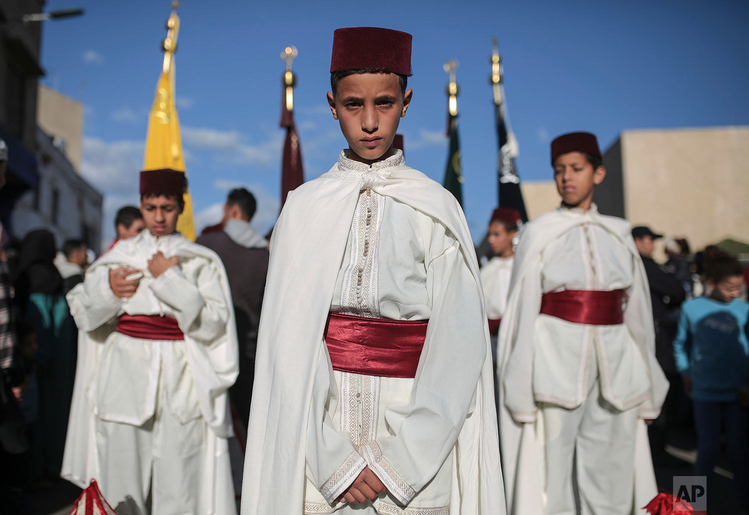 In this Thursday Nov. 30, 2017 photo, children take part in an annual parade celebrating the birth anniversary of Prophet Muhammad, in Sale, near Rabat, Morocco, Thursday. (AP Photo/Mosa'ab Elshamy)